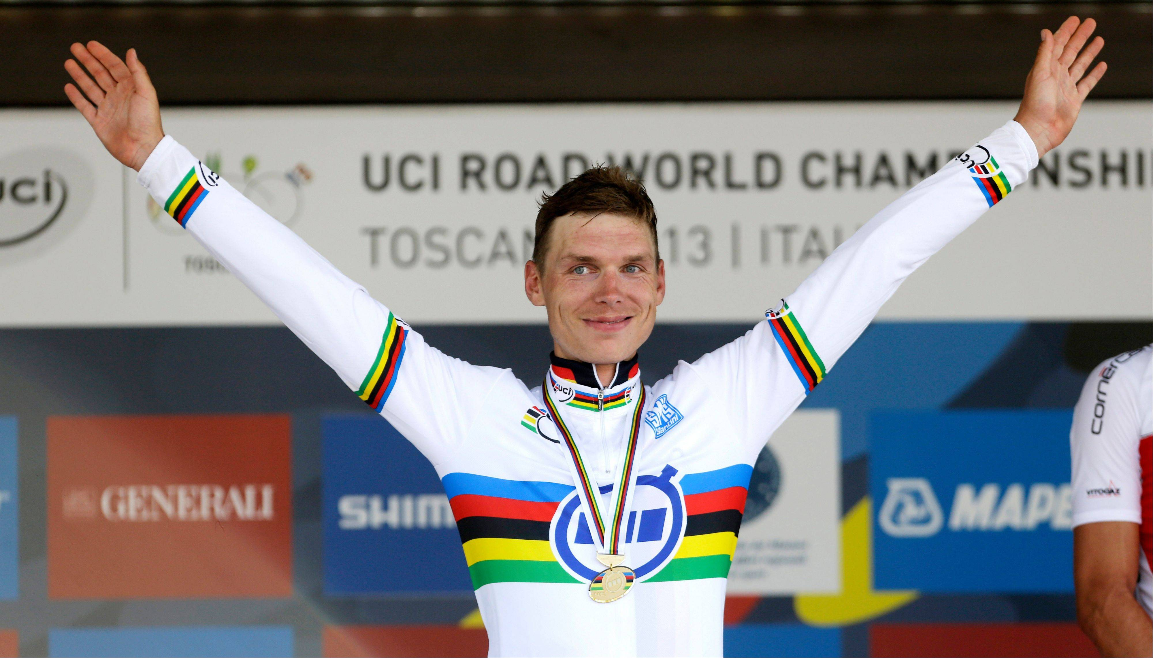Tony Martin celebrates on the podium with the gold medal he won in the men's individual time trial at the road cycling world championships Wednesday in Florence, Italy.