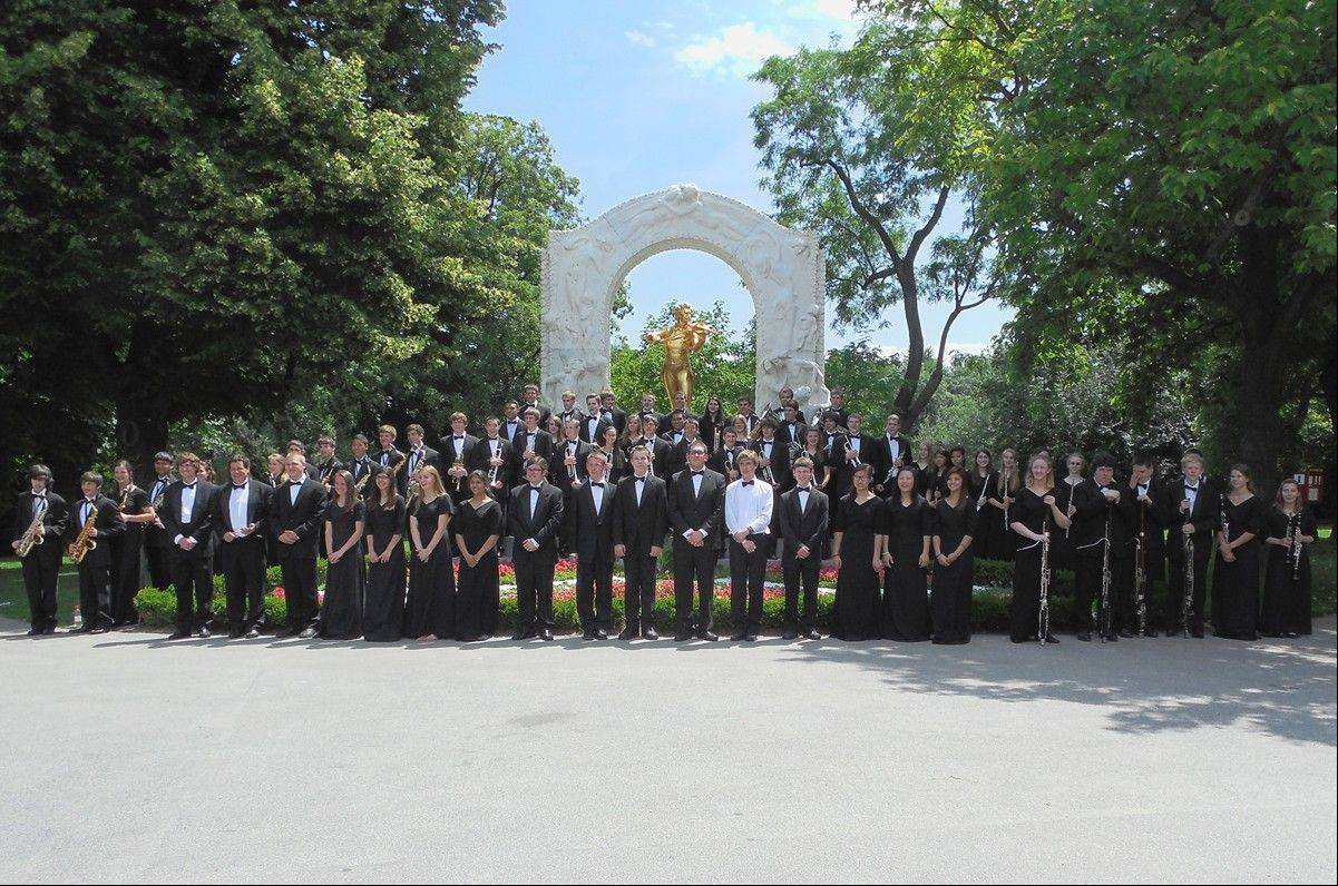 The Buffalo Grove High School Band poses this past June in front of the Johann Strauss II Memorial in Stadt Park in Vienna, Austria, after their concert performance there.