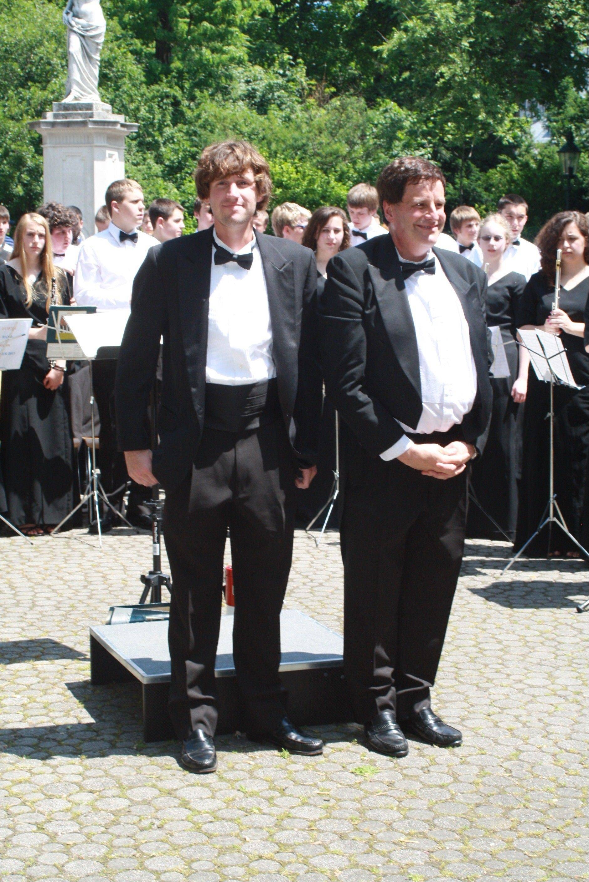 Band Director Ed Jacobi and his son, Andrew Jacobi, who is the director of bands at Richwoods High School in Peoria and who also conducted the Buffalo Grove Band in Europe this summer pose after the concert performance in Stadt Park in Vienna this past June at the memorial to Johann Strauss II.