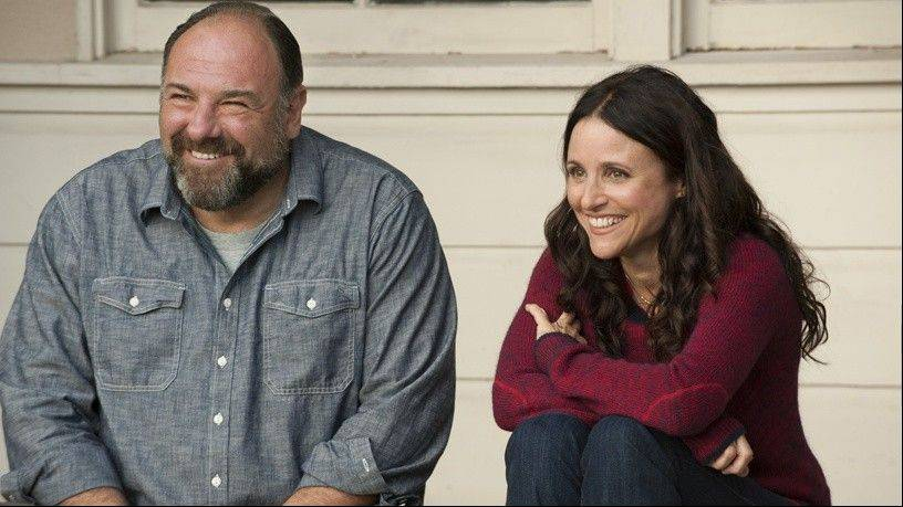 "Albert (the late James Gandolfini) shares a gentle moment with Eva (Julia Louis-Dreyfus) in Nicole Holofcener's superb romantic comedy ""Enough Said."""