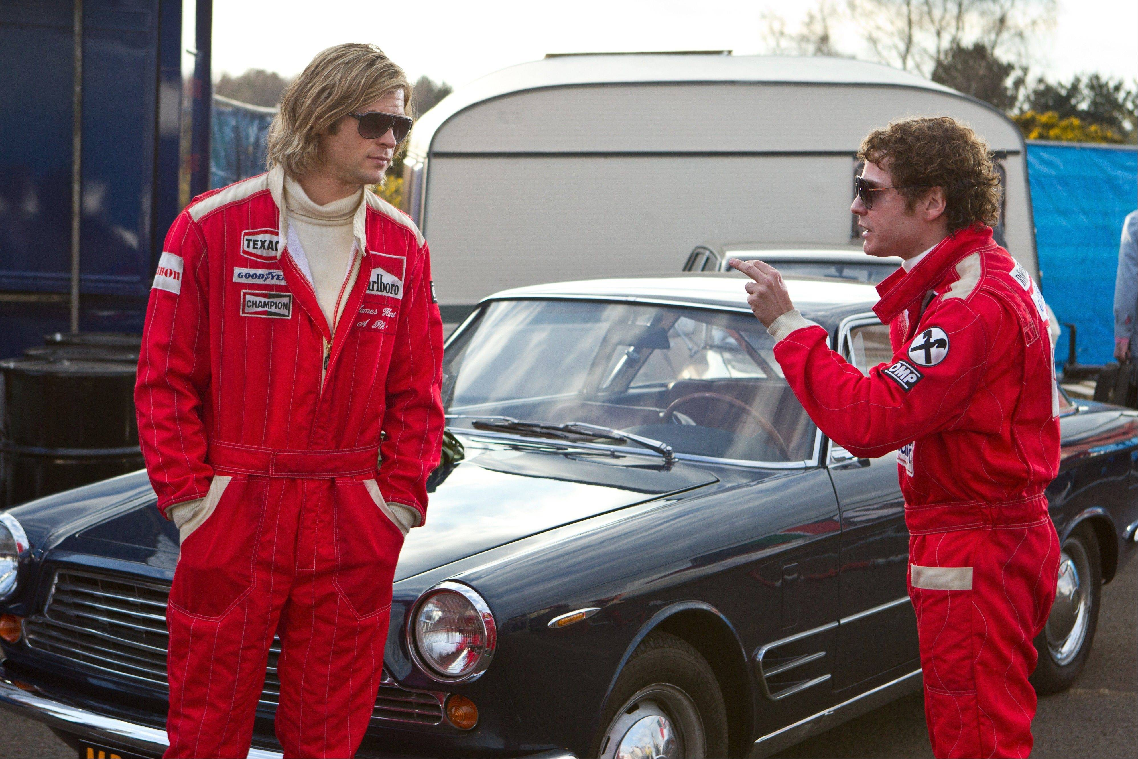 "James Hunt (Chris Hemsworth), left, shares a fierce rivalry with Niki Lauda (Daniel Bruhl) in Ron Howard's formula Formula One race drama ""Rush."""