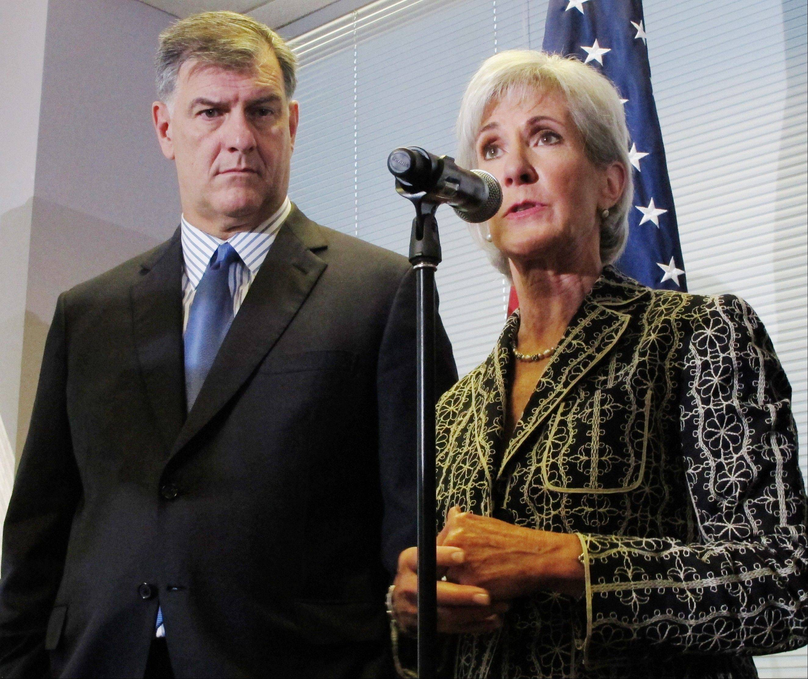 U.S. Health and Human Services Secretary Kathleen Sebelius, right, with Dallas Mayor Mike Rawlings, discusses the implementation of the federal health care overhaul in Dallas on Thursday. Sebelius and Rawlings discussed the impending overhaul�s importance to North Texas.