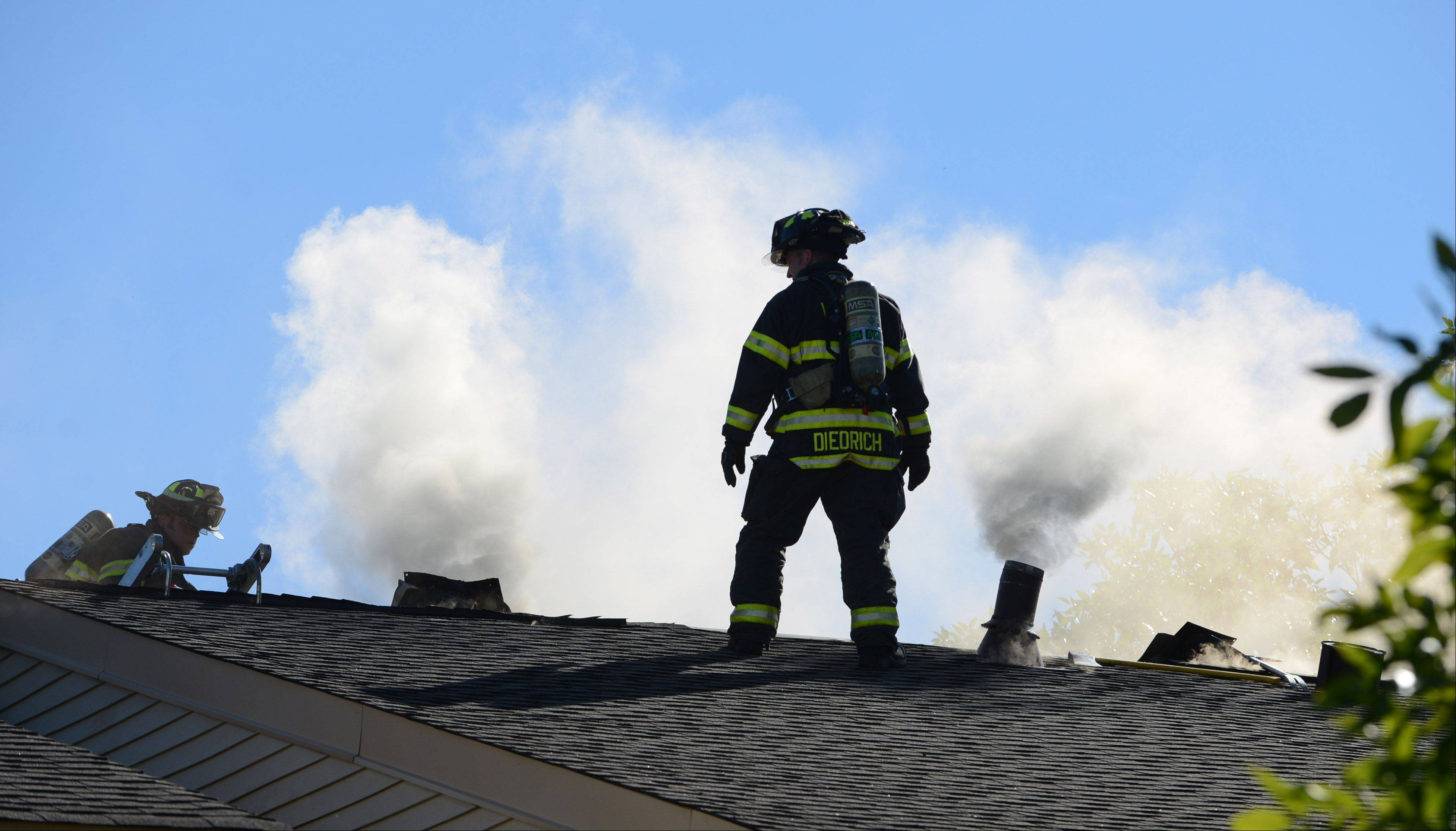 Fire officials respond to a fire on the second floor of a multifamily structure on Commonwealth Court in Vernon Hills Thursday afternoon. Officials report a police officer was injured but the extent of his injuries are not available.