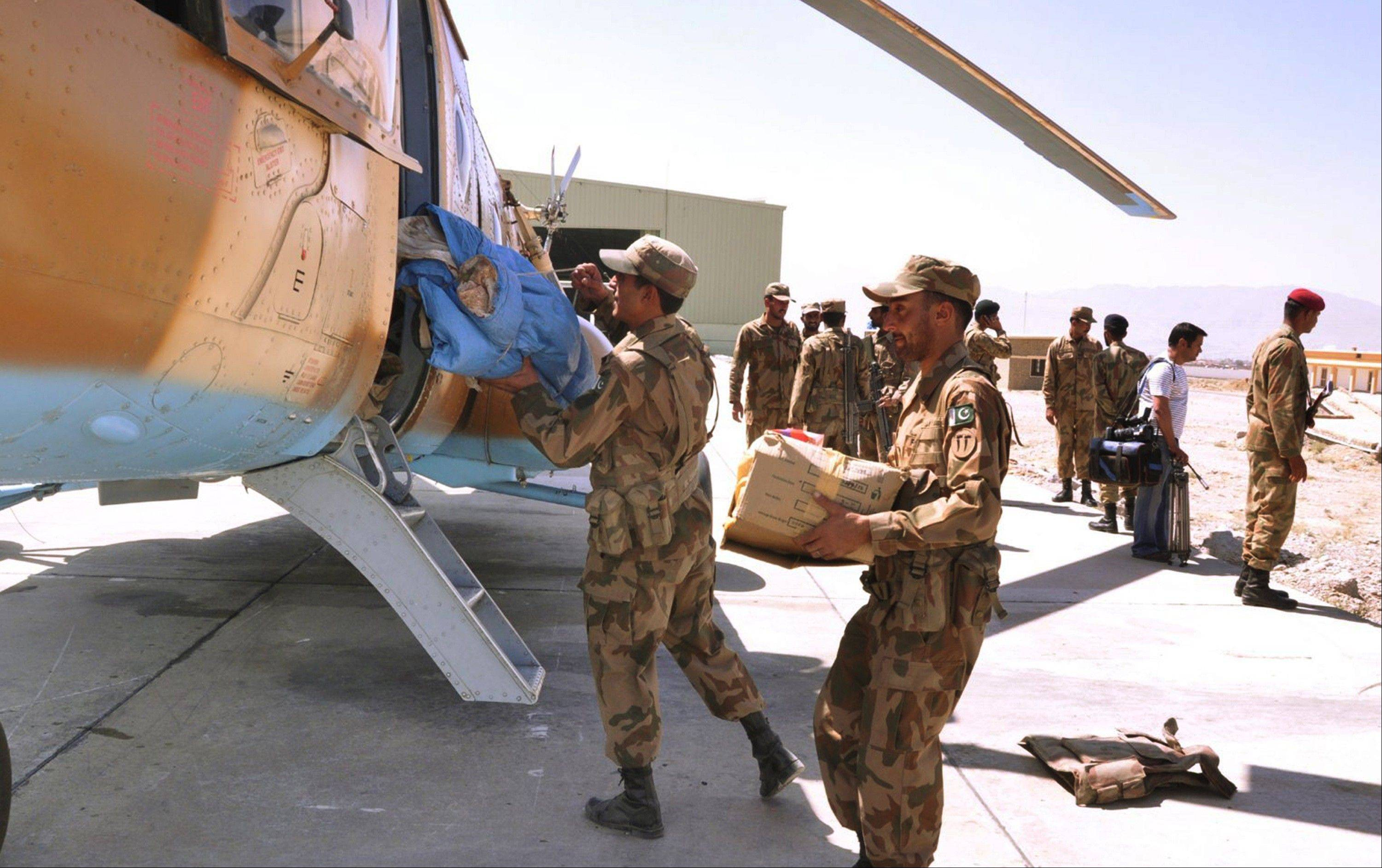 Pakistan army troops load relief goods for earthquake-affected areas, in Rawalpindi, Pakistan, Wednesday, Sept. 25, 2013. Rescuers struggled Wednesday to help thousands of people injured and left homeless after their houses collapsed in a massive earthquake in southwestern Pakistan Tuesday, Sept. 24, 2013, as the death toll rose to hundreds.