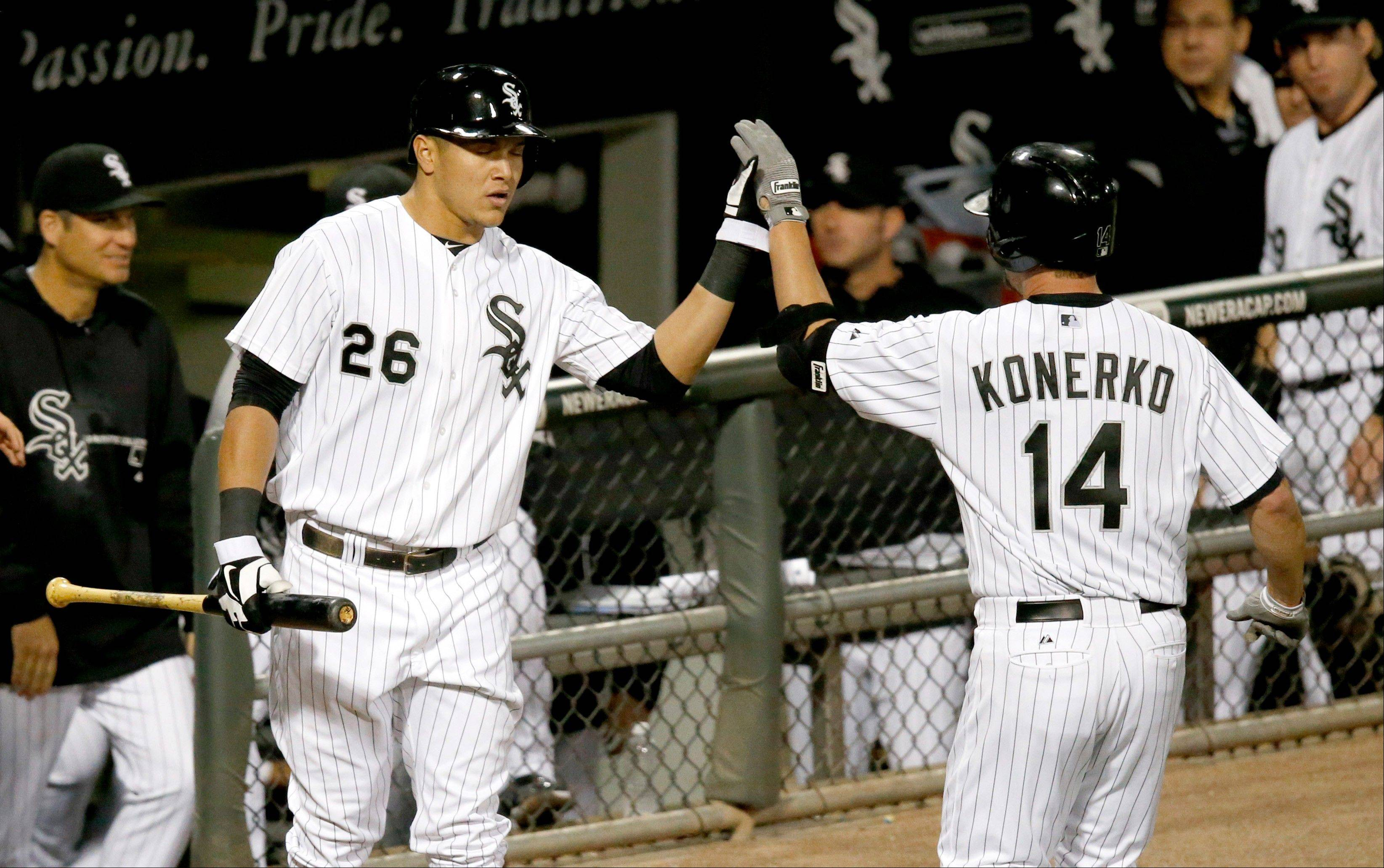 The White Sox� Avisail Garcia (26) greets Paul Konerko outside the dugout after Konerko�s home run off Royals starting pitcher Jeremy Guthrie in the second inning Thursday night at U.S. Cellular Field.