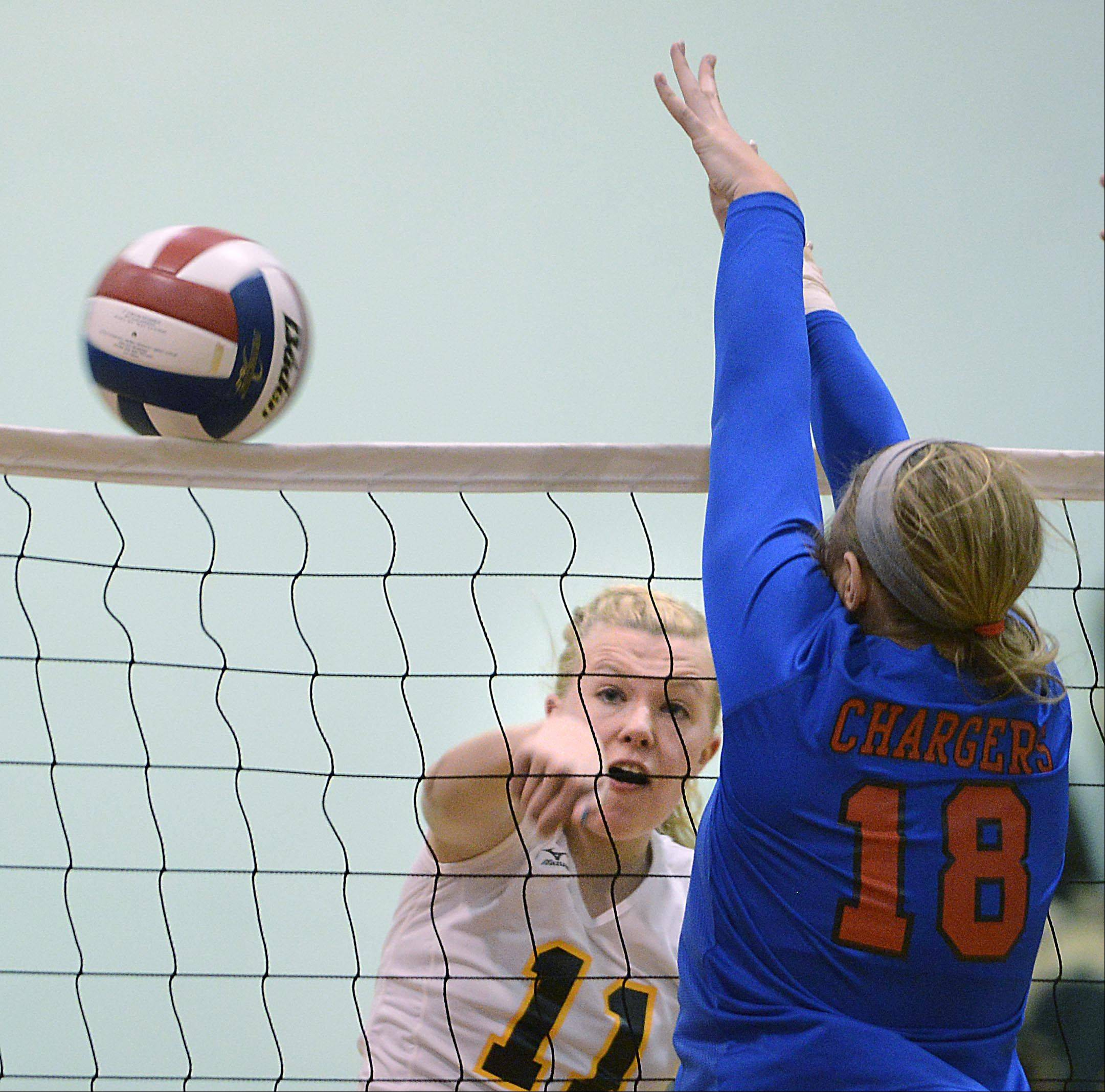 Jacobs� Bridgett Wallenberger hits the net and gets the shot past Dundee-Crown�s Kailey Moll Thursday in Carpentersville.