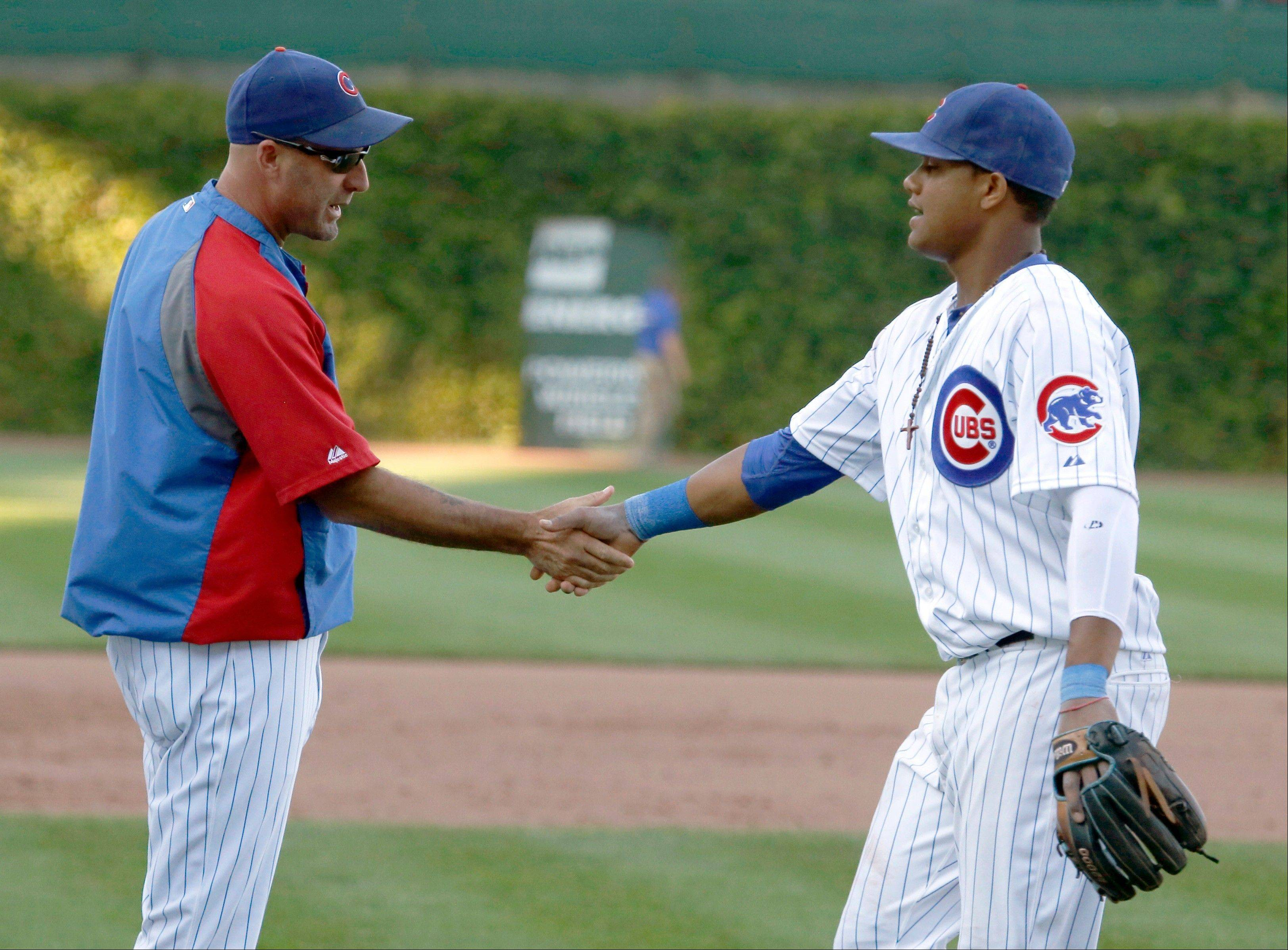The Cubs' manager Dale Sveum greets shortstop Starlin Castro after the Cubs' 4-2 win over the Pittsburgh Pirates Wednesday in their last home baseball game of the season.