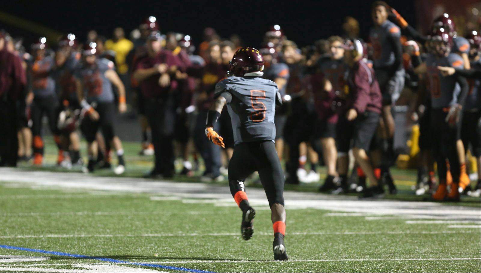 Montini�s Derrick Curry picks off a St. Francis pass for a 92-yard touchdown run.