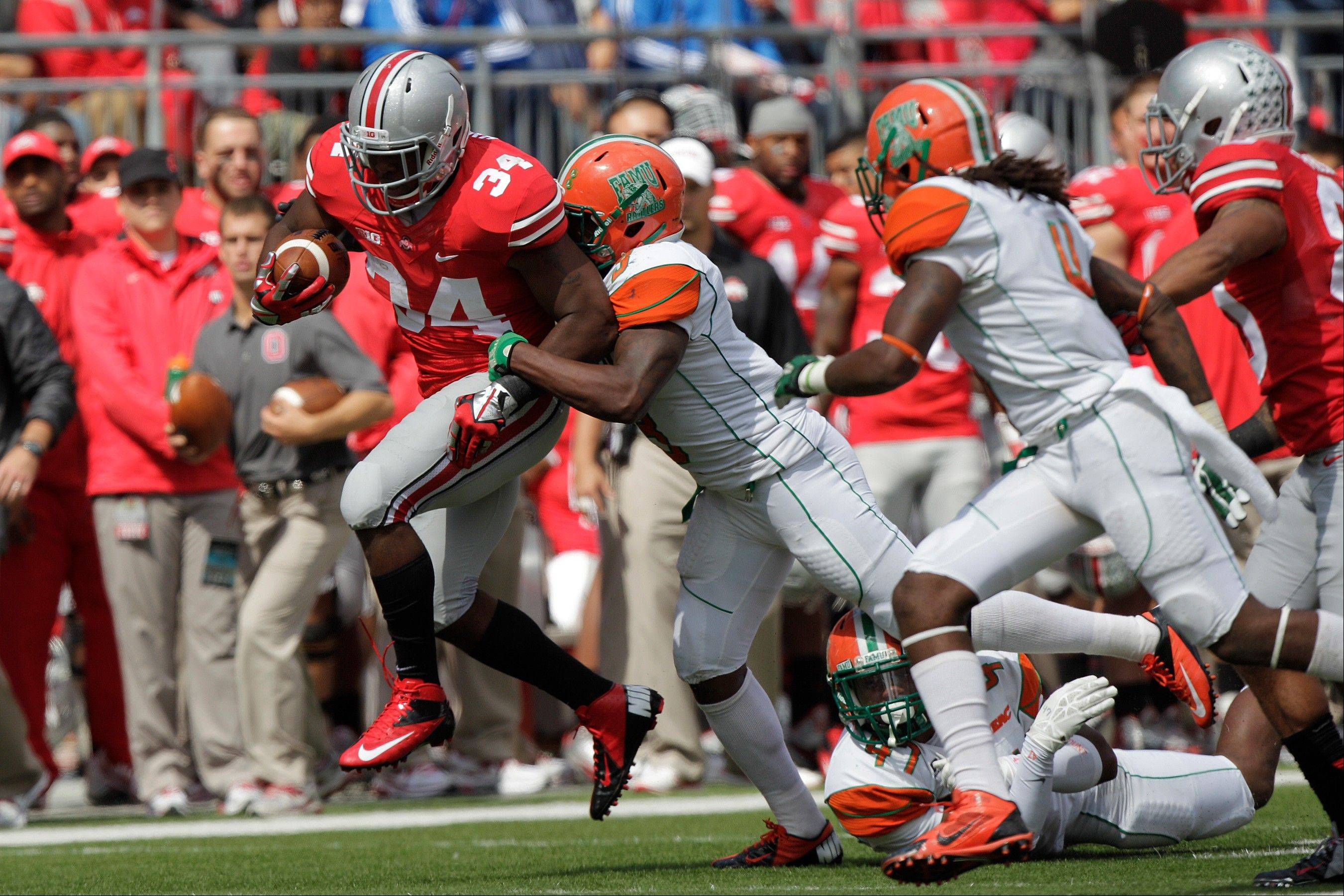 Ohio State running back Carlos Hyde gains yardage against Florida A&M during the Sept. 21 game in Columbus, Ohio. While rolling over four hapless nonconference opponents, No. 4 Ohio State has hardly been challenged.
