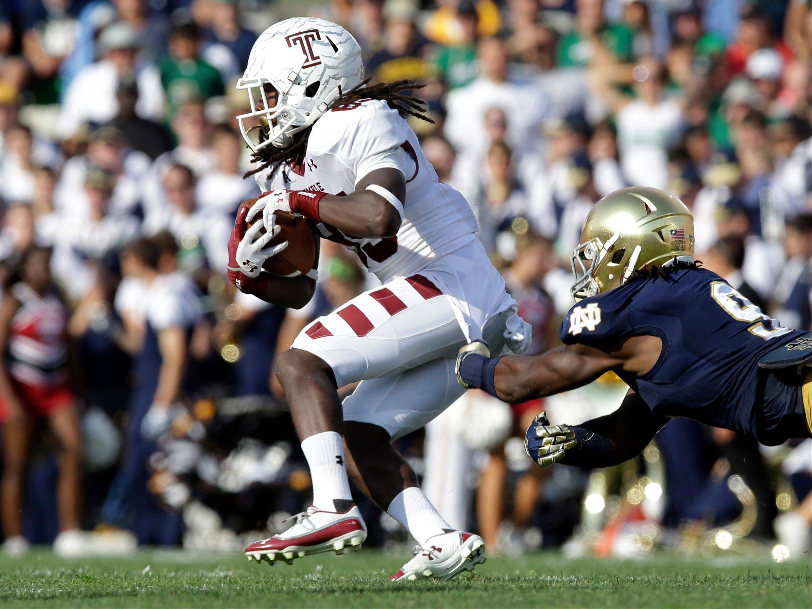 Notre Dame linebacker Jaylon Smith tackles Temple wide receiver Nate Hairston during the second half of the Aug. 31 game in South Bend, Ind.