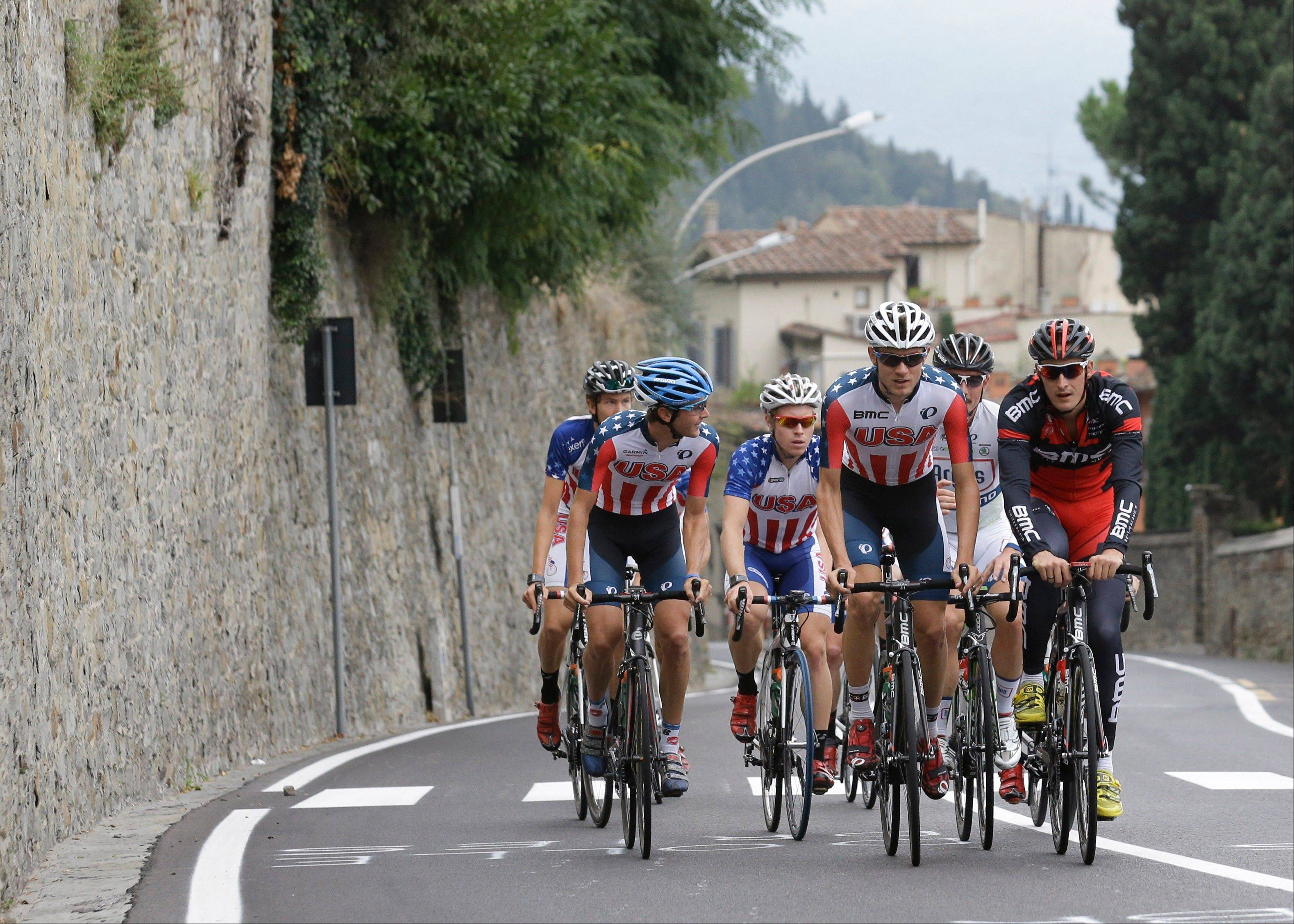 American cyclist Tejay van Garderen, second from right, trains with his teammates during a no-race day at the road cycling world championships Thursday in near Florence, Italy.