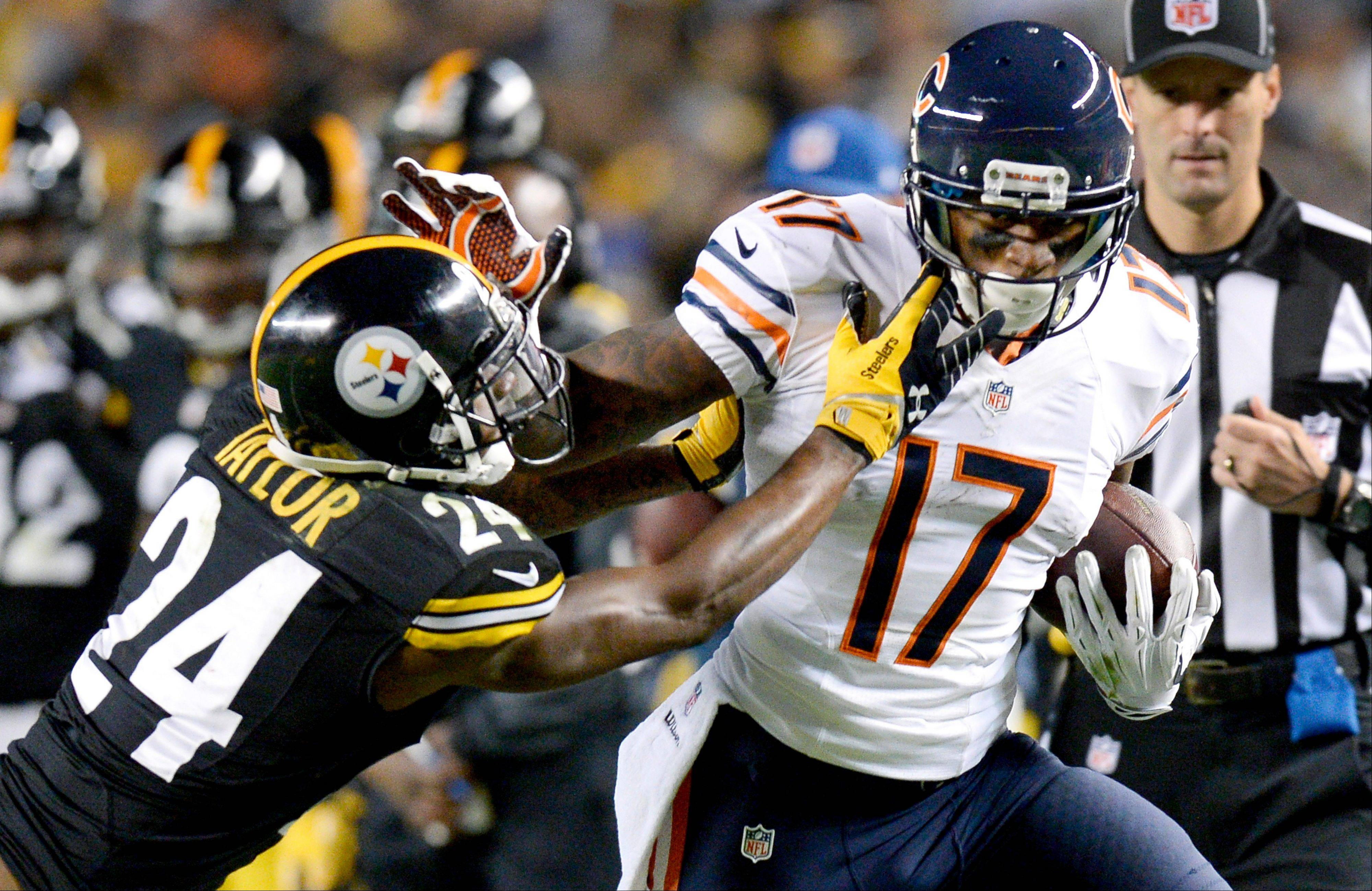 Bears wide receiver Alshon Jeffery (17) is hit by Pittsburgh Steelers cornerback Ike Taylor (24) after making a catch in the third quarter of an NFL football game Sunday in Pittsburgh. The National Football League is teaming up with Twitter Inc. to post video highlights of games on the microblogging site and share the advertising revenue.