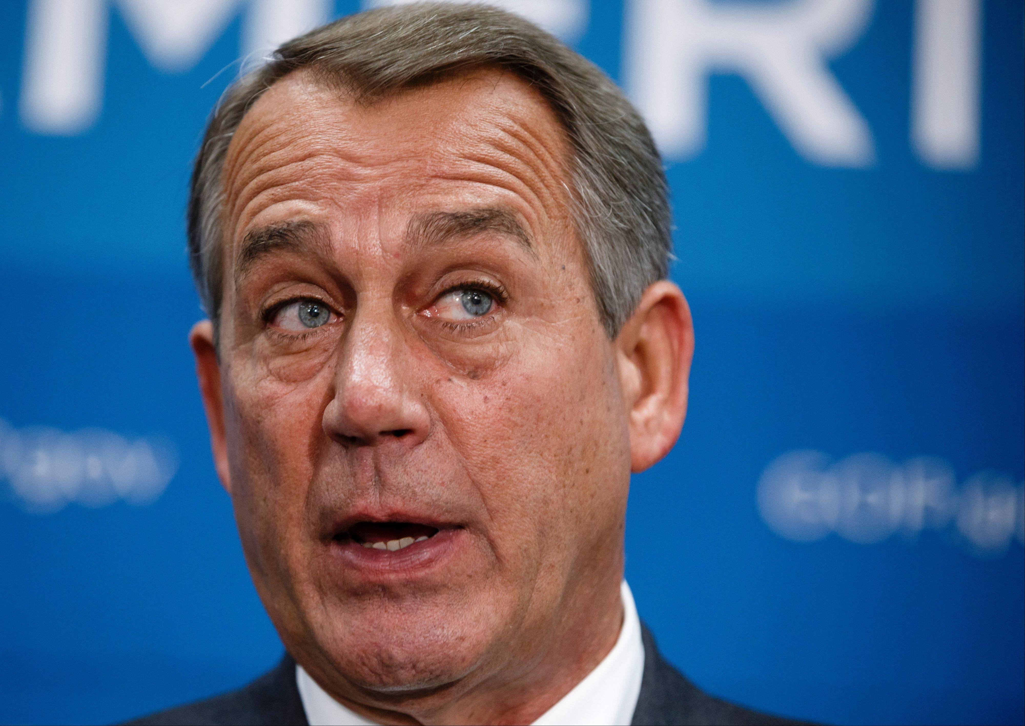 House Speaker John Boehner speaks to reporters Thursday after a closed-door strategy session. Pressure is building on fractious Republicans to prevent a partial government shutdown.