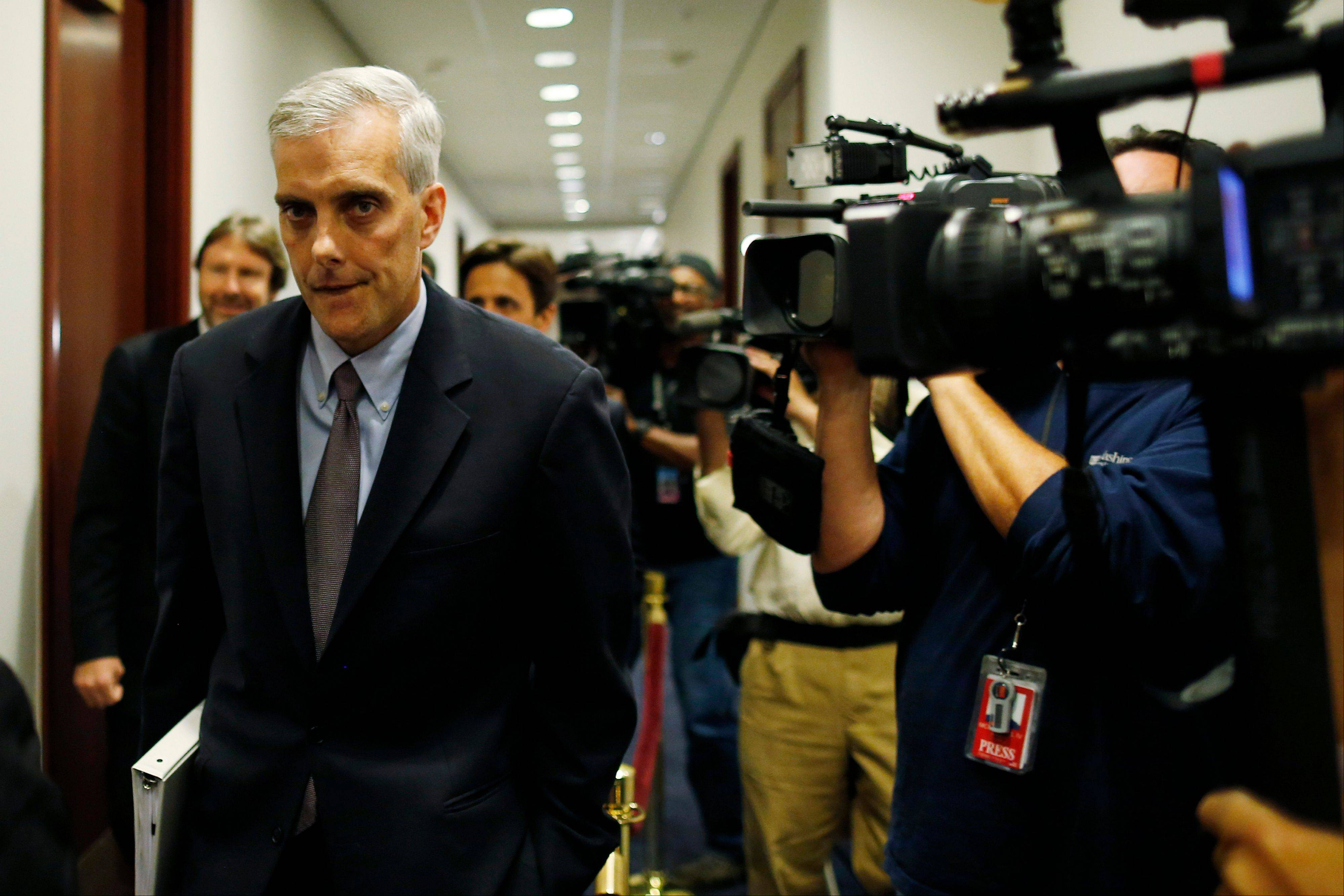 White House Chief of Staff Denis McDonough walks past reporters as he arrives to meet with the House Democratic Caucus regarding the looming government shutdown on Capitol Hill in Washington, Wednesday.