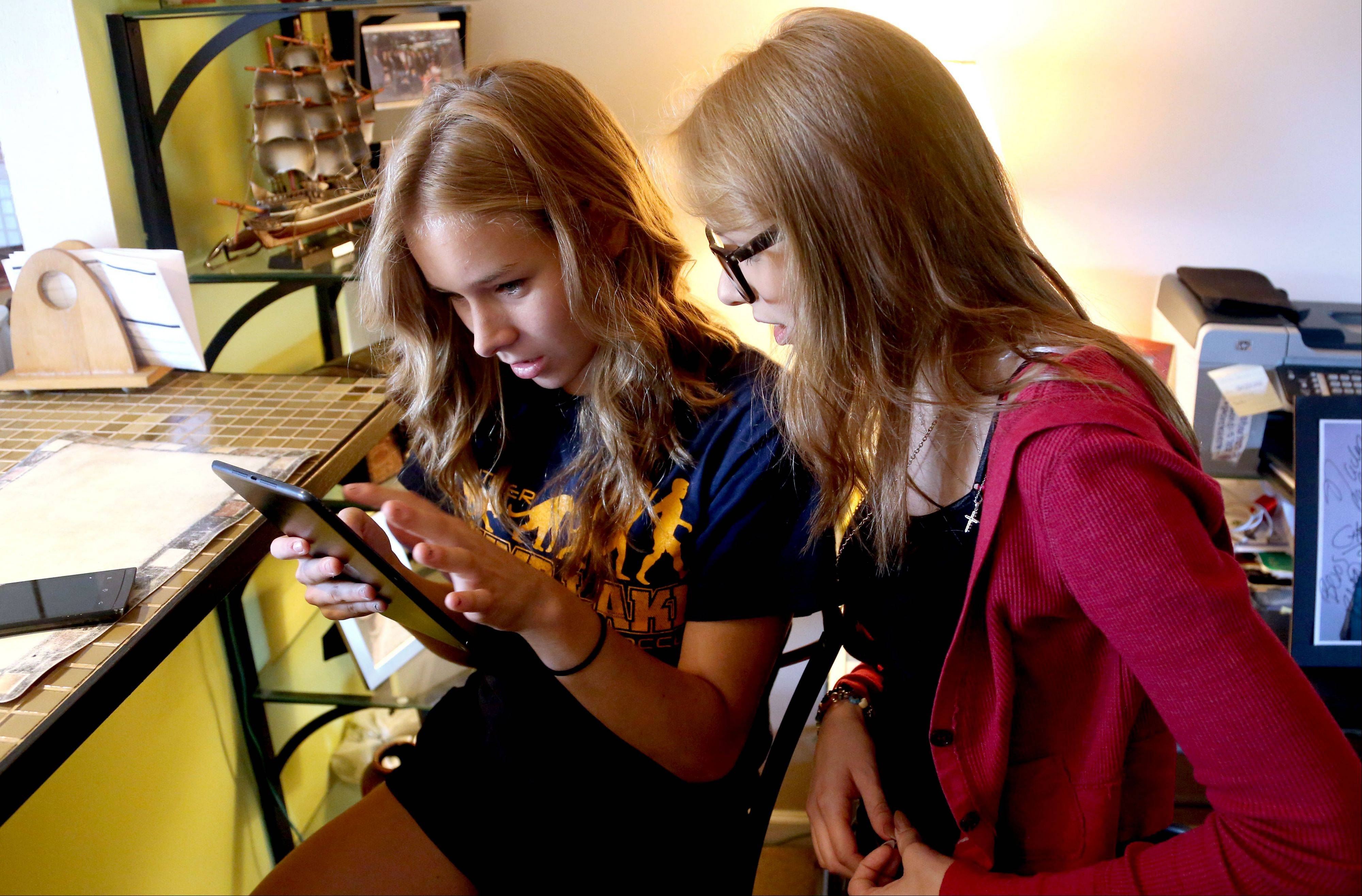 "Sisters Brenda Barrios, 16, and Brisila Barros, 15, of Round Lake Beach look through YouTube videos of Brisila singing on ""El Factor X,""a Spanish-language version of Simon Cowell�s ""X Factor"" franchise."