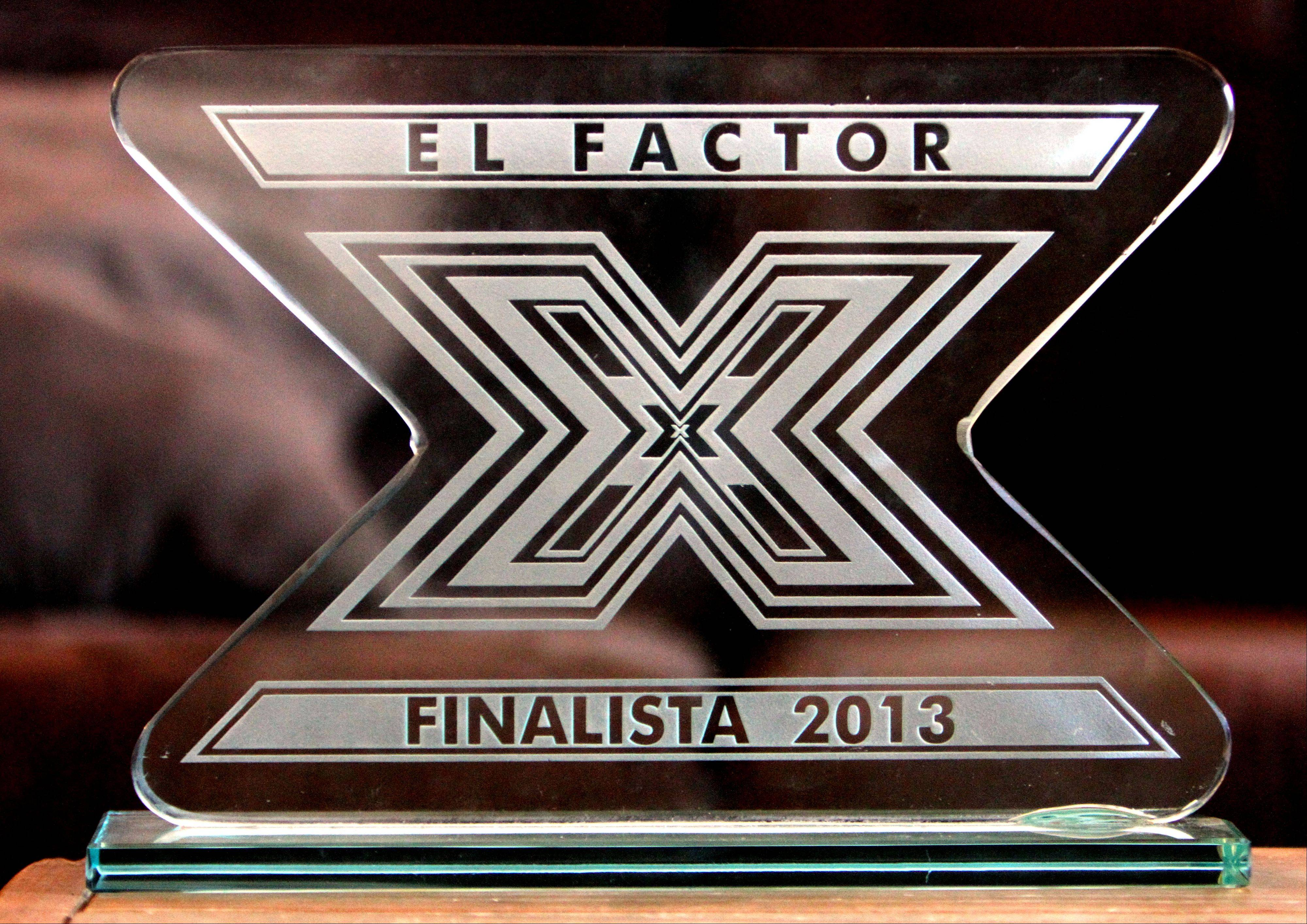 "Brisila Barros received this trophy for finishing fourth on ""El Factor X."""