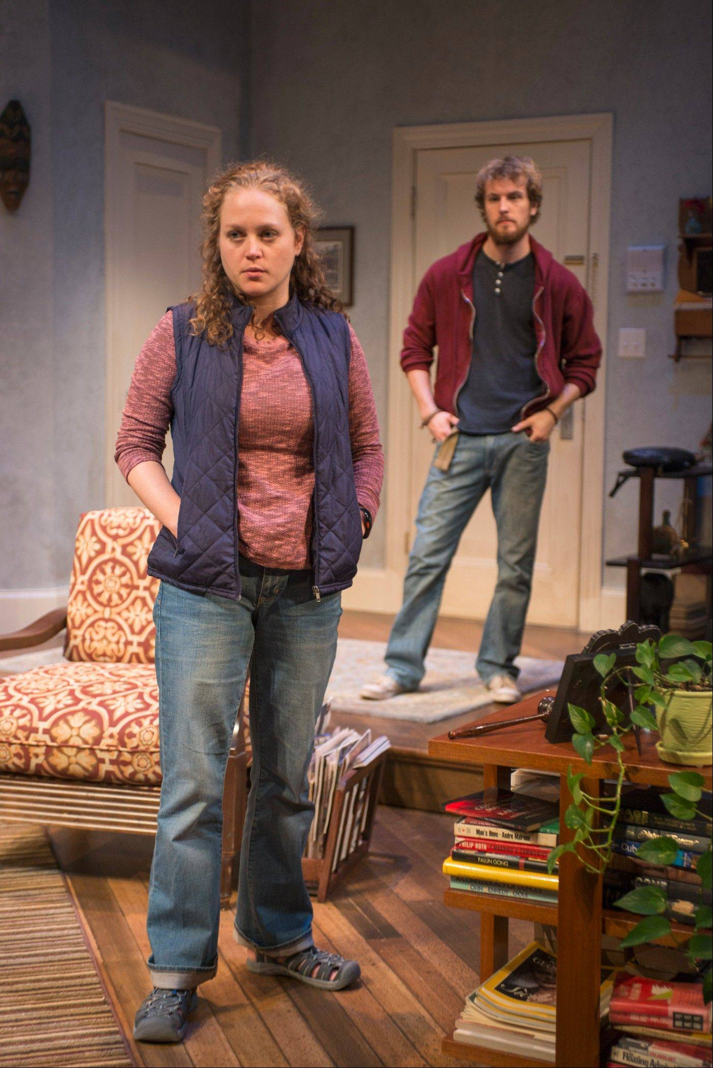 "After bicycling cross country, Leo (Josh Salt) encounters his strangely distant girlfriend Bec (Caroline Neff) in Amy Herzog's family drama ""4000 Miles"" running through Oct. 20 at Skokie's Northlight Theatre."