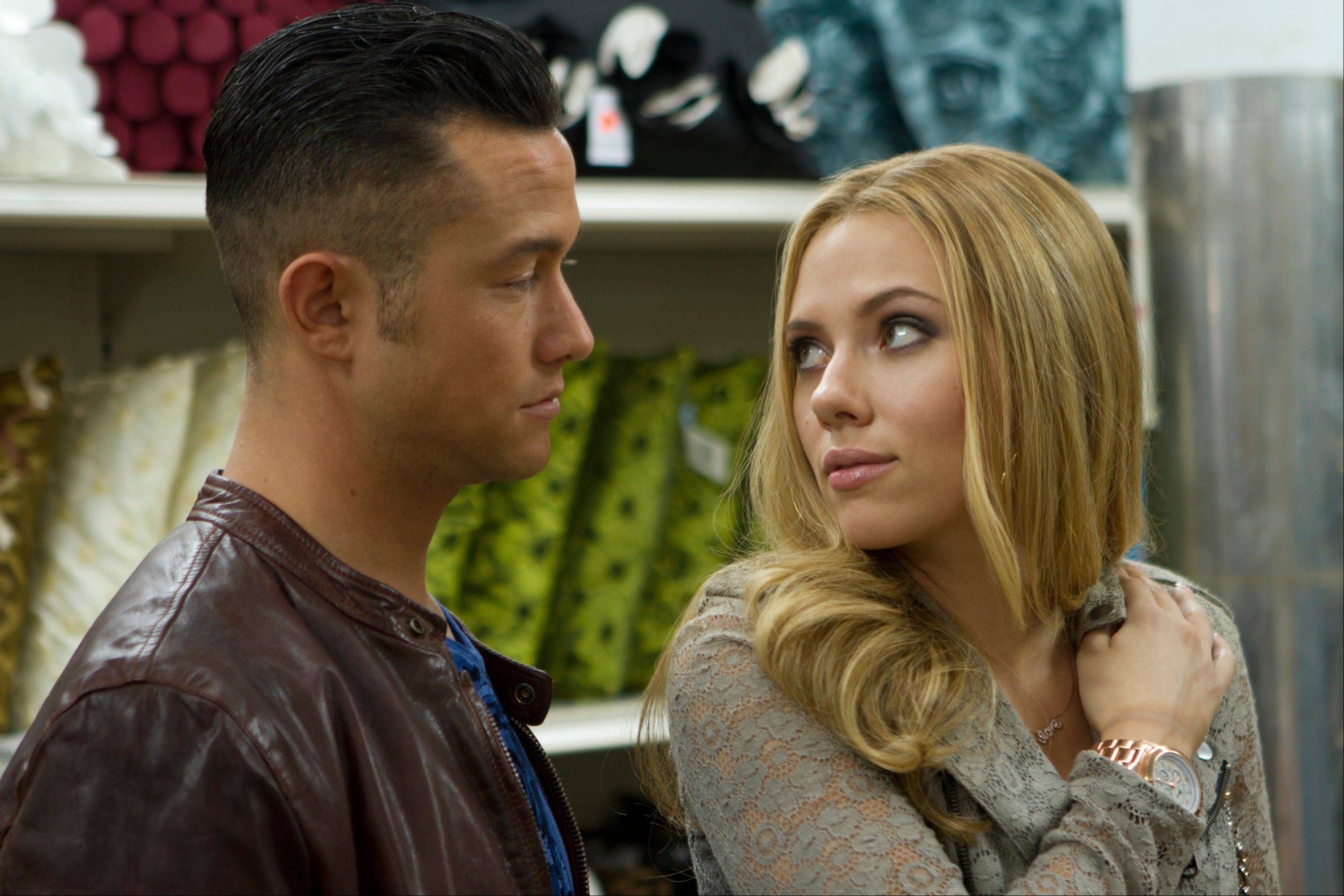 "Jon (writer/director Joseph Gordon-Levitt) schmoozes with Barbara (Scarlett Johansson) in the strange and timely romantic comedy ""Don Jon."""