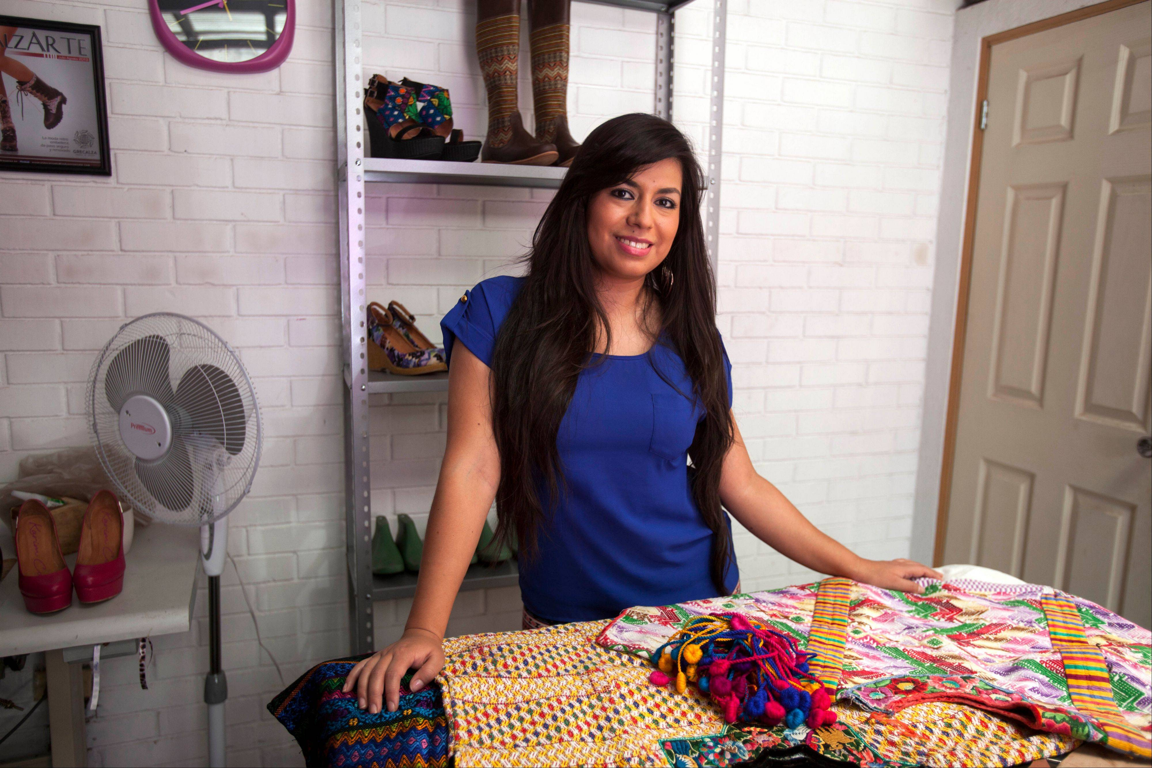 "Shoe designer Karim Corzo is using Guatemalan textiles in her designs at her factory in Guatemala City. Corzo saw an economic benefit to the fashion trend. ""They allow us to give work to the women who weave them and sell them,"" Corzo said."