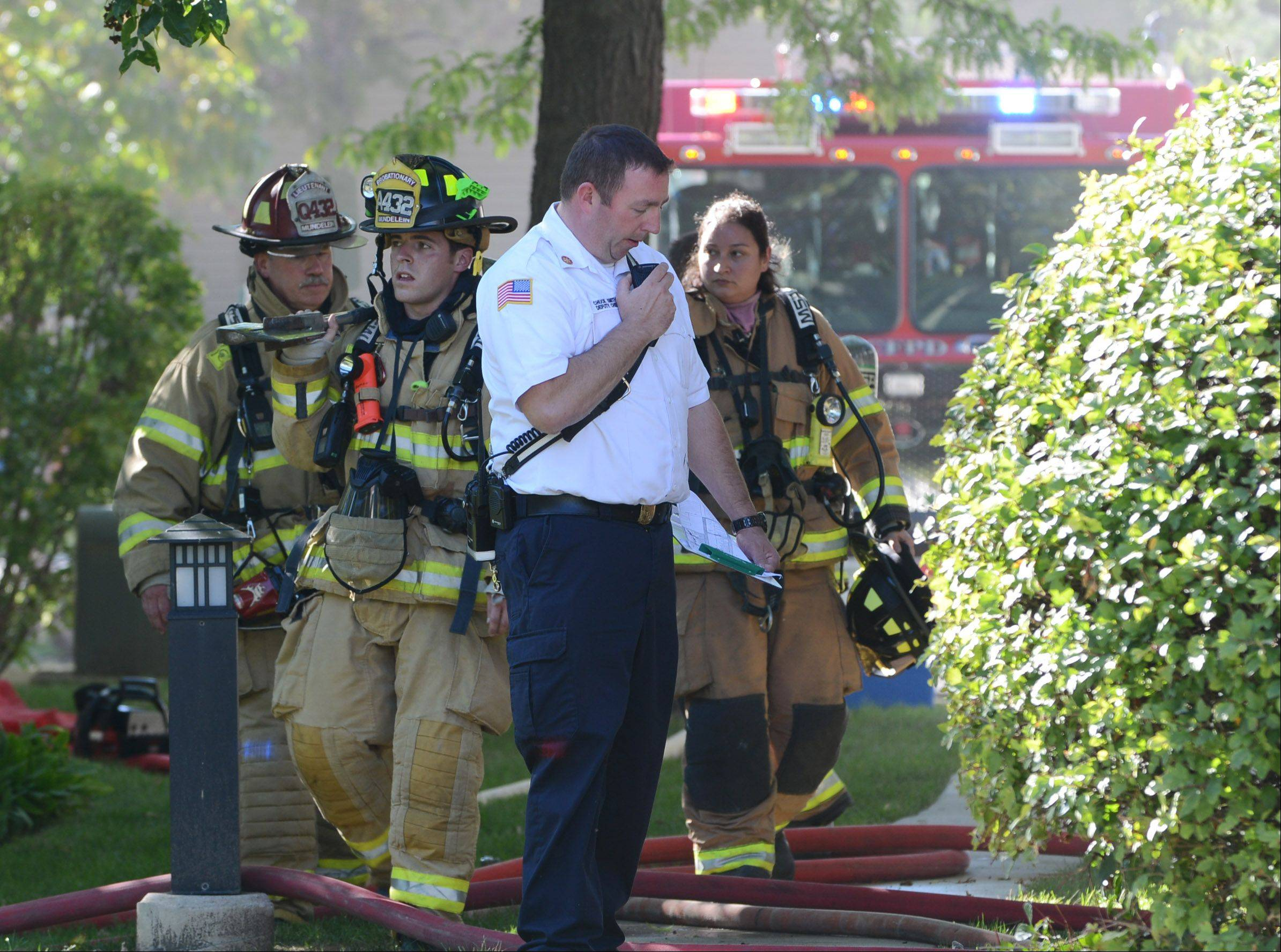 Firefighters on the scenes of a multifamily structure on Commonwealth Court in Vernon Hills Thursday afternoon.