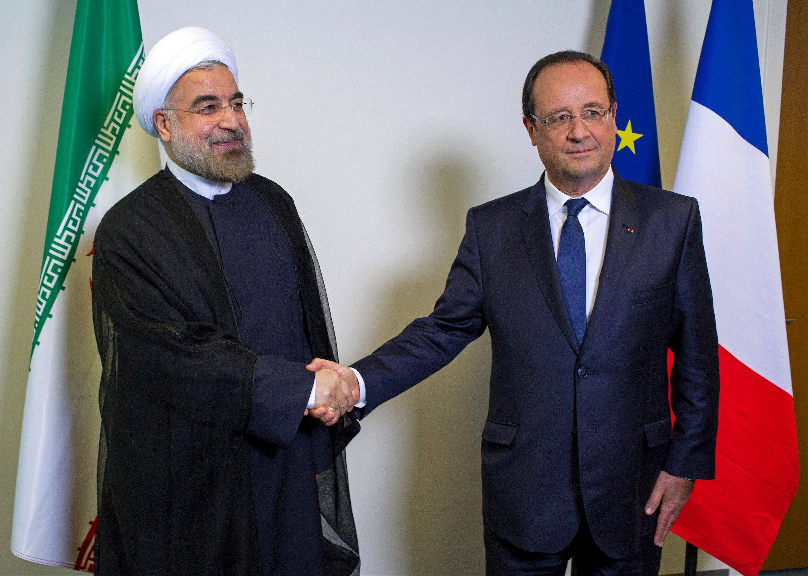 Iranian President Hasan Rouhani shakes hands with French President Francois Hollande during the 68th session of the United Nations General Assembly at