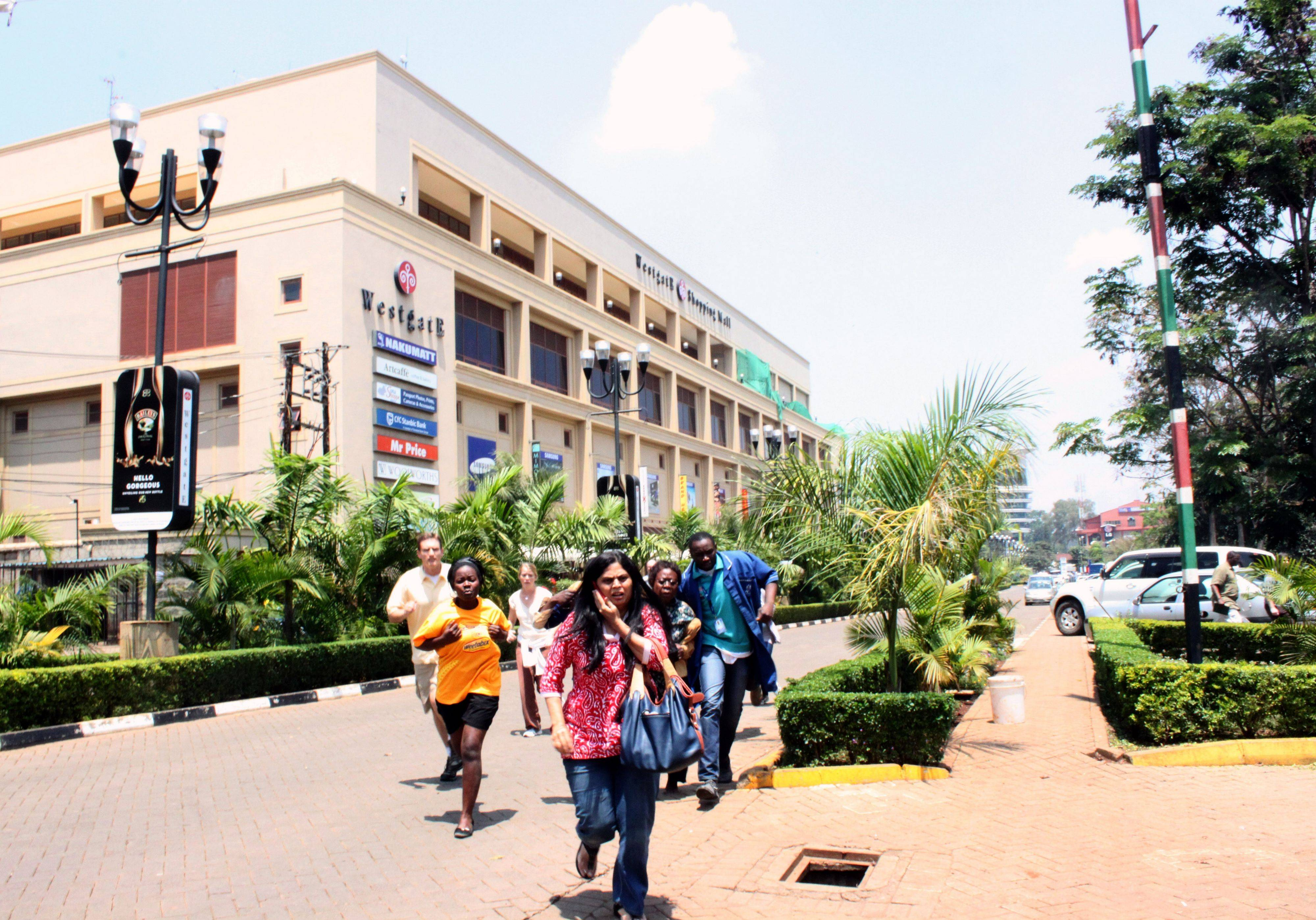 People run from the Westgate Mall, an upscale shopping mall in Nairobi, Kenya, where shooting erupted Saturday when armed men staged an attack.