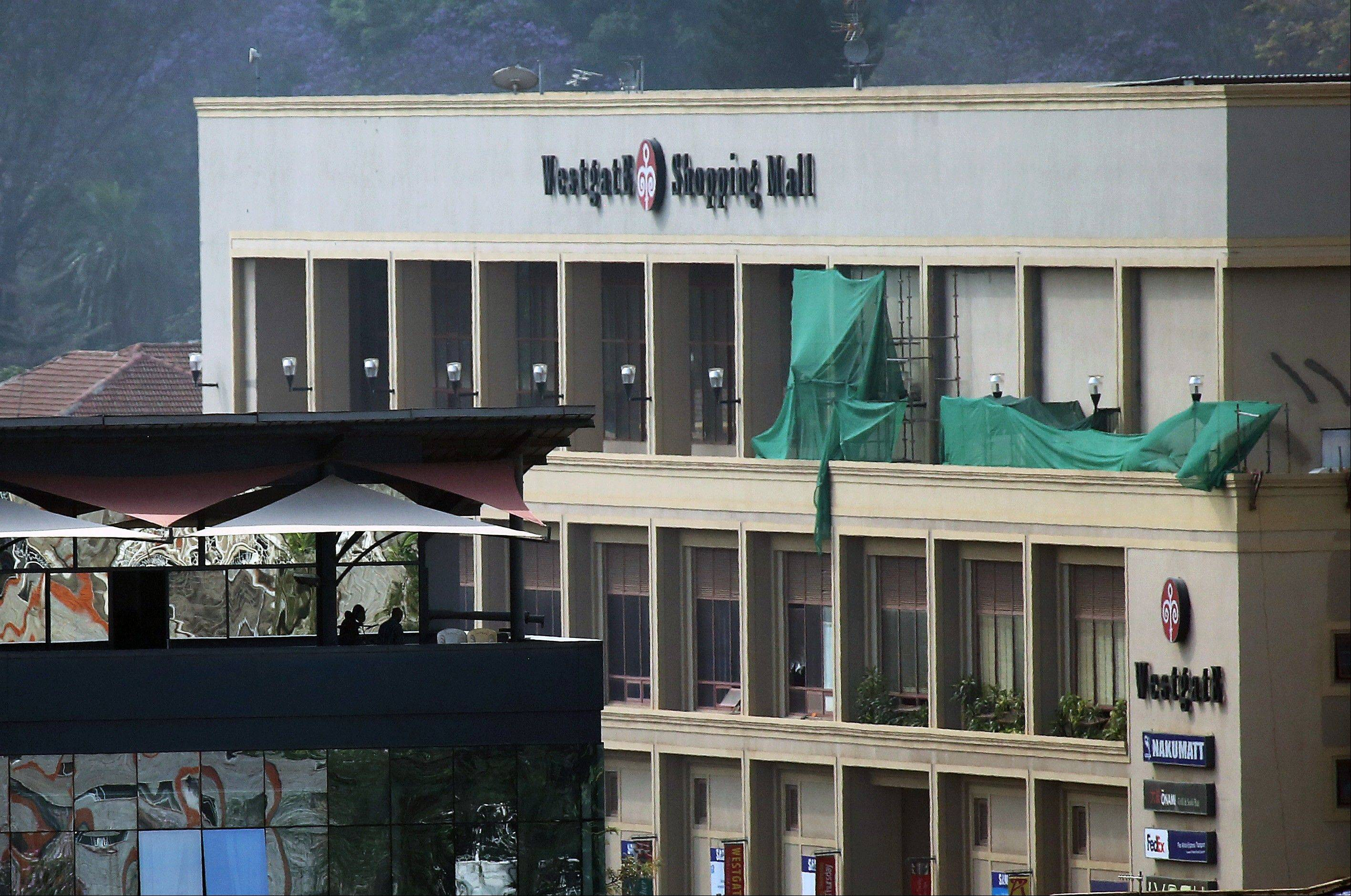 Kenyan security forces stand on the top floor of a building facing the Westgate Mall on Wednesday in Nairobi, Kenya.