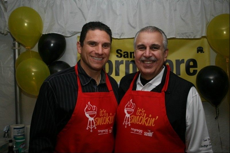 Bloomingdale Mayor Franco Coladipietro, left, got help from county board member Sam Tornatore during last year's 50 Men Who Cook event in Bloomingdale. Coladipietro is back this year with his pork, steak and chicken tacos.