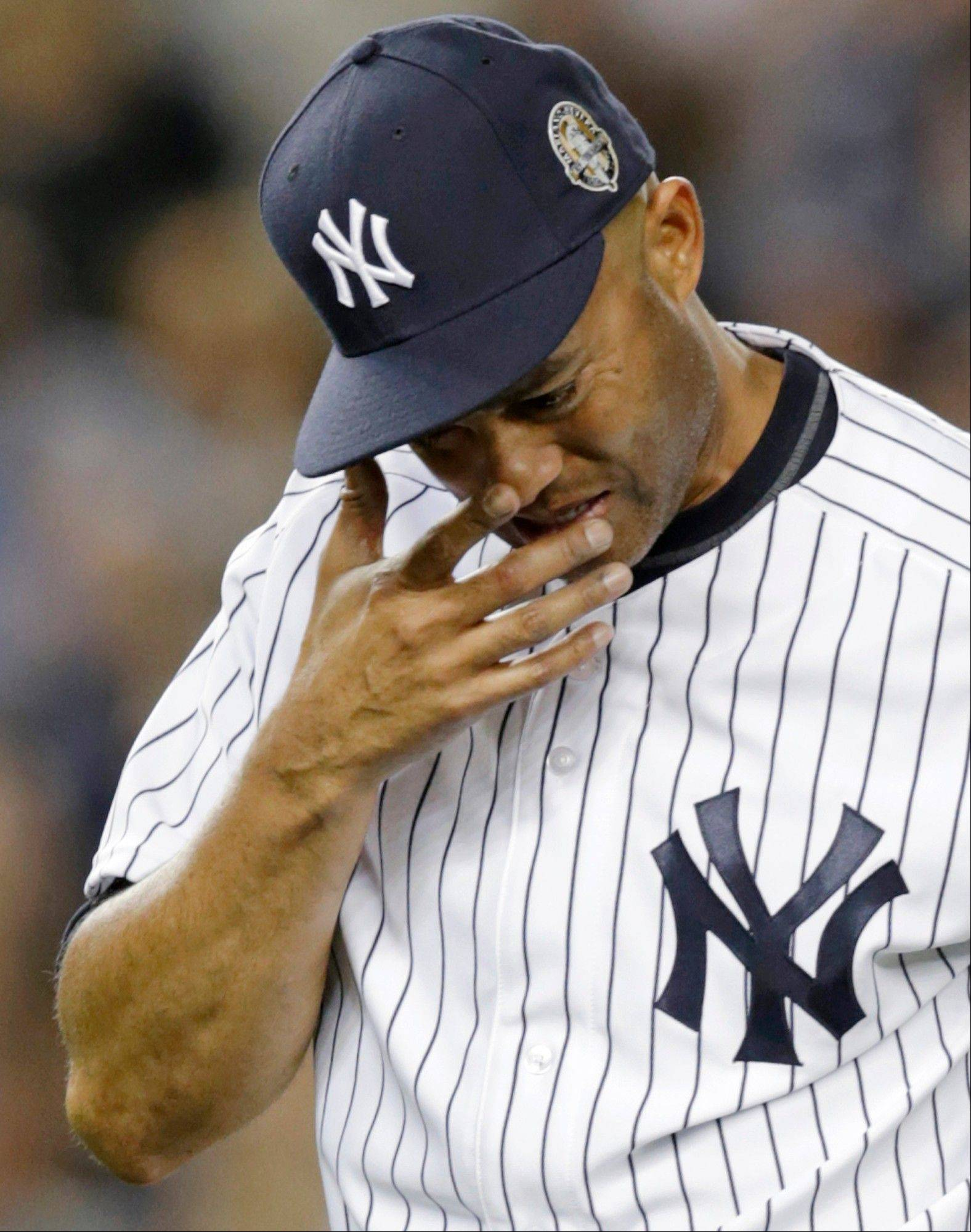 New York Yankees relief pitcher Mariano Rivera cries as he leaves Thursday's game with two outs in the ninth inning of his final appearance at Yankee Stadium.