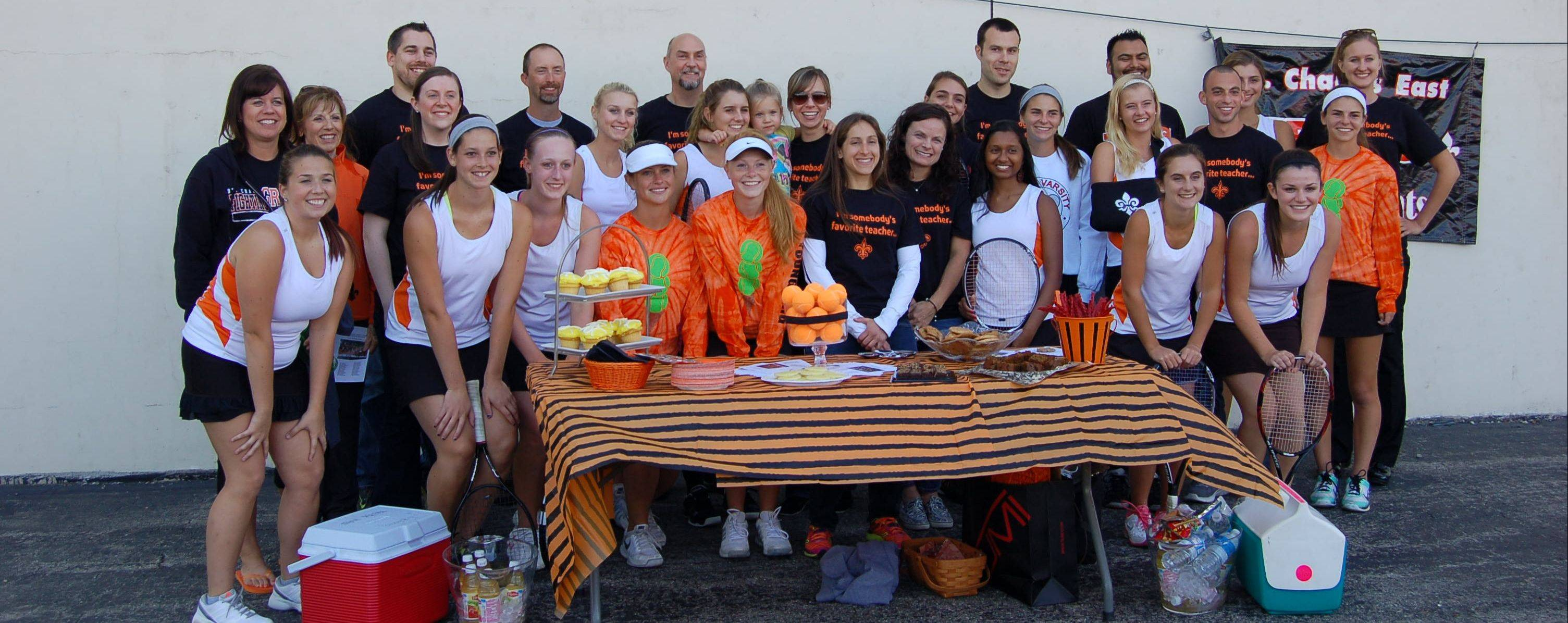 The St. Charles East girls tennis program has been busy helping others in the community this fall including making back packs for needy children and raising money for the Northern Illinois Food Bank.