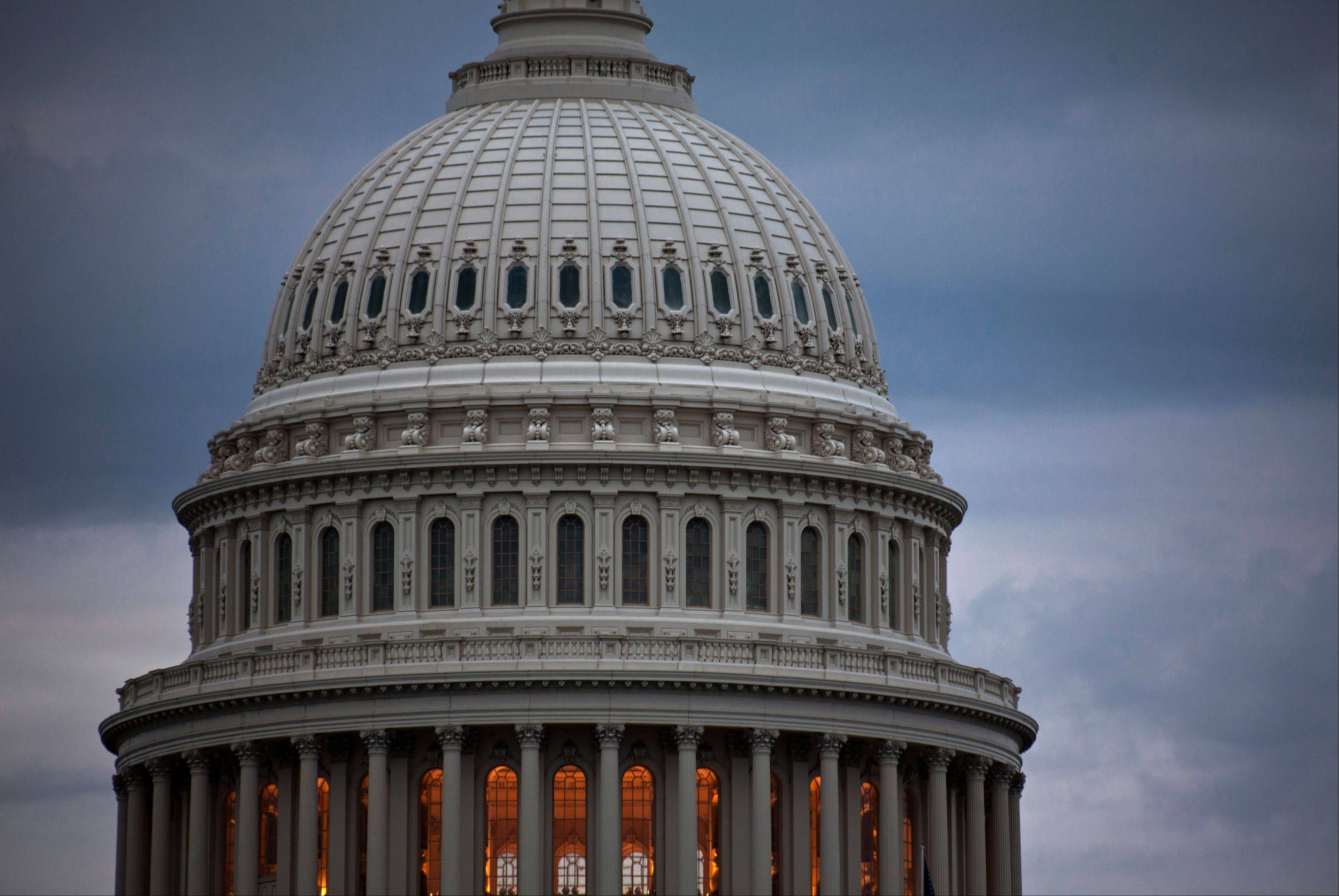 Storm clouds hang over Capitol Hill Friday in Washington. The average decline in the Standard & Poor�s 500 index during a shutdown lasting 10 days or more is about 2.5 percent.