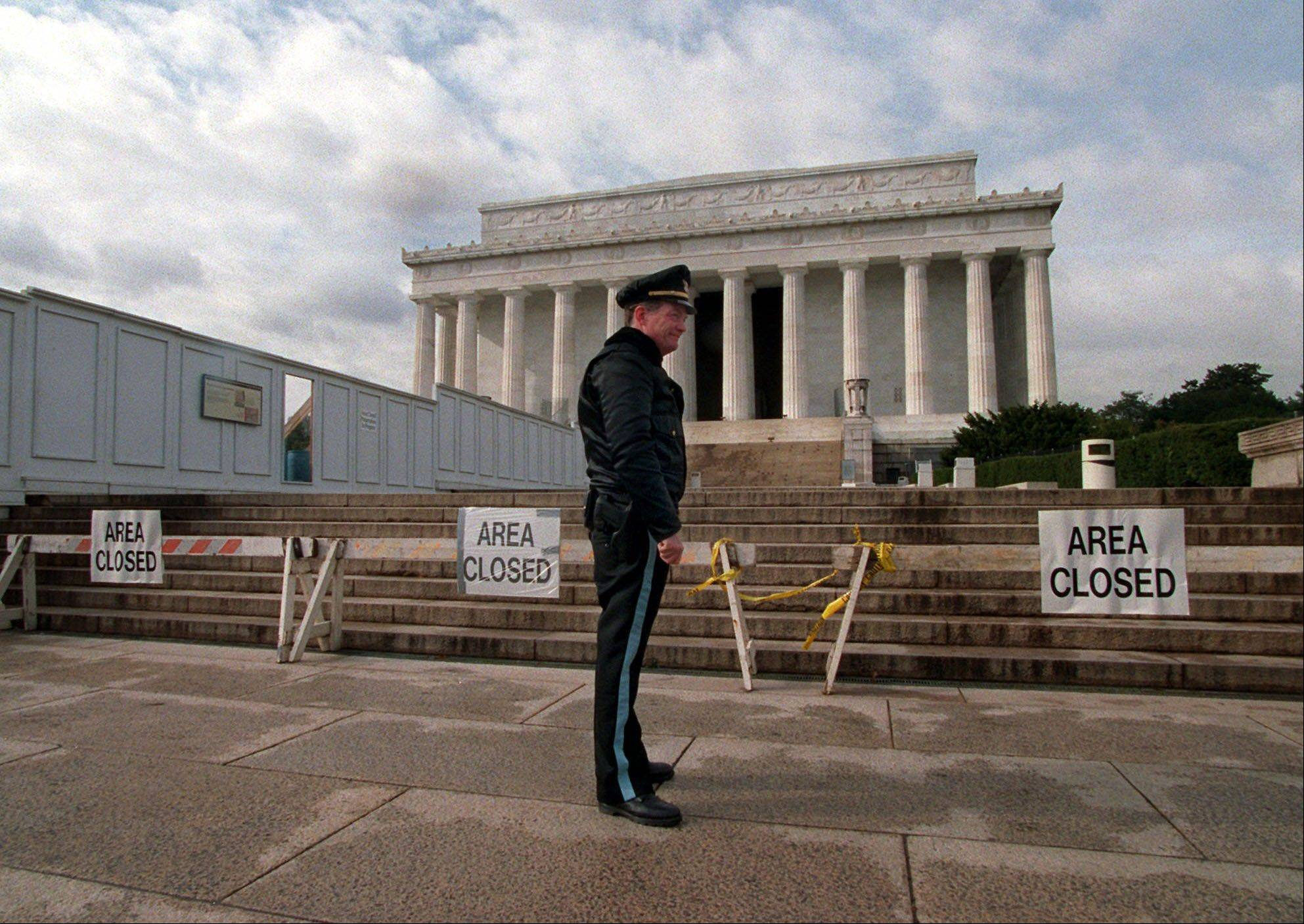 U.S. Park Service Police Officer P.G. Carroll stands in front of closed signs at the Lincoln Memorial in Washington, during a partial shutdown of the federal government. There have been 17 government shutdowns since 1976, ranging in length from one to 21 days.