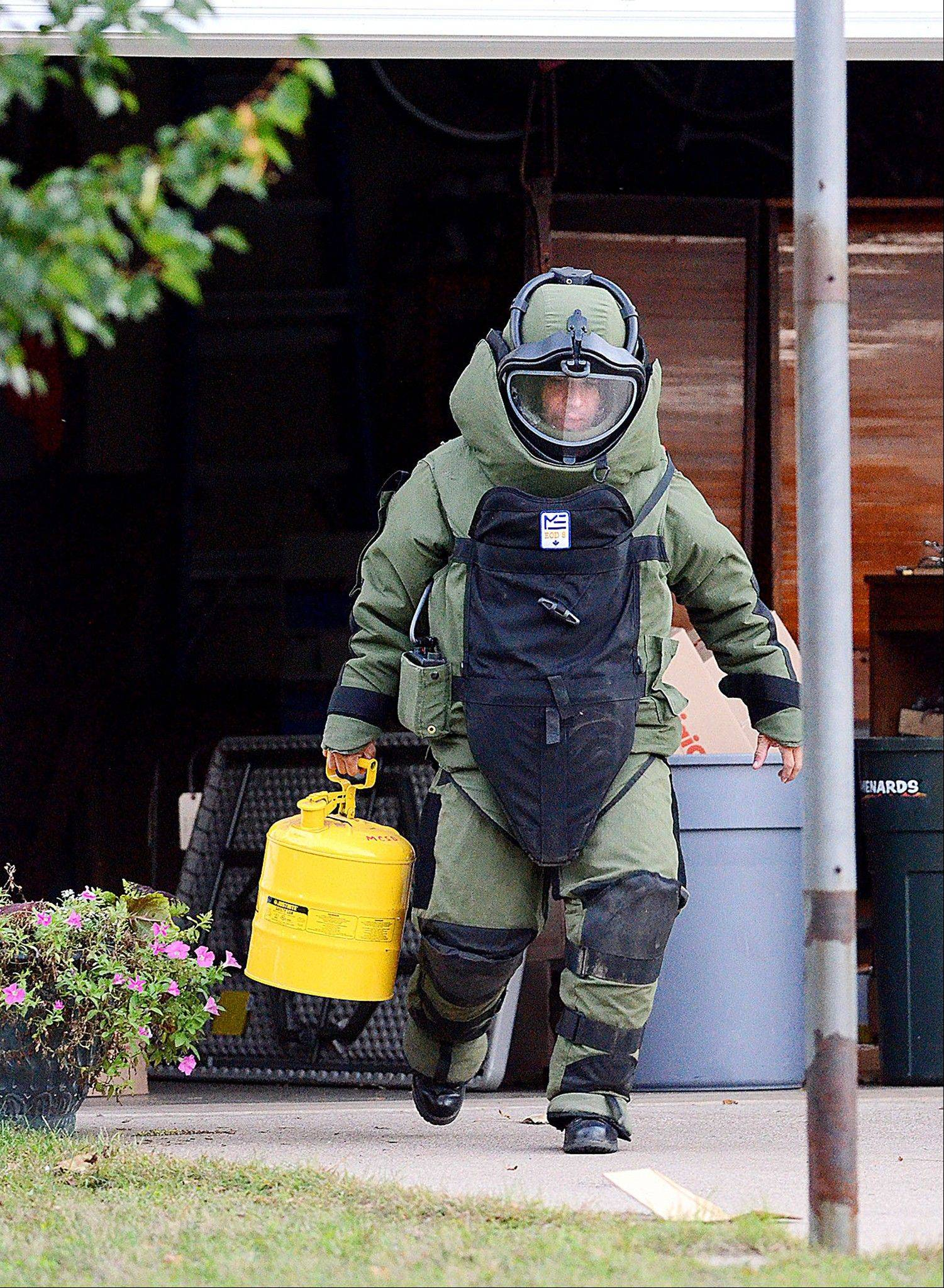 A member of the Marathon Oneida County Bomb Squad responds Thursday for removal of railroad torpedoes in Eau Claire, Wis.