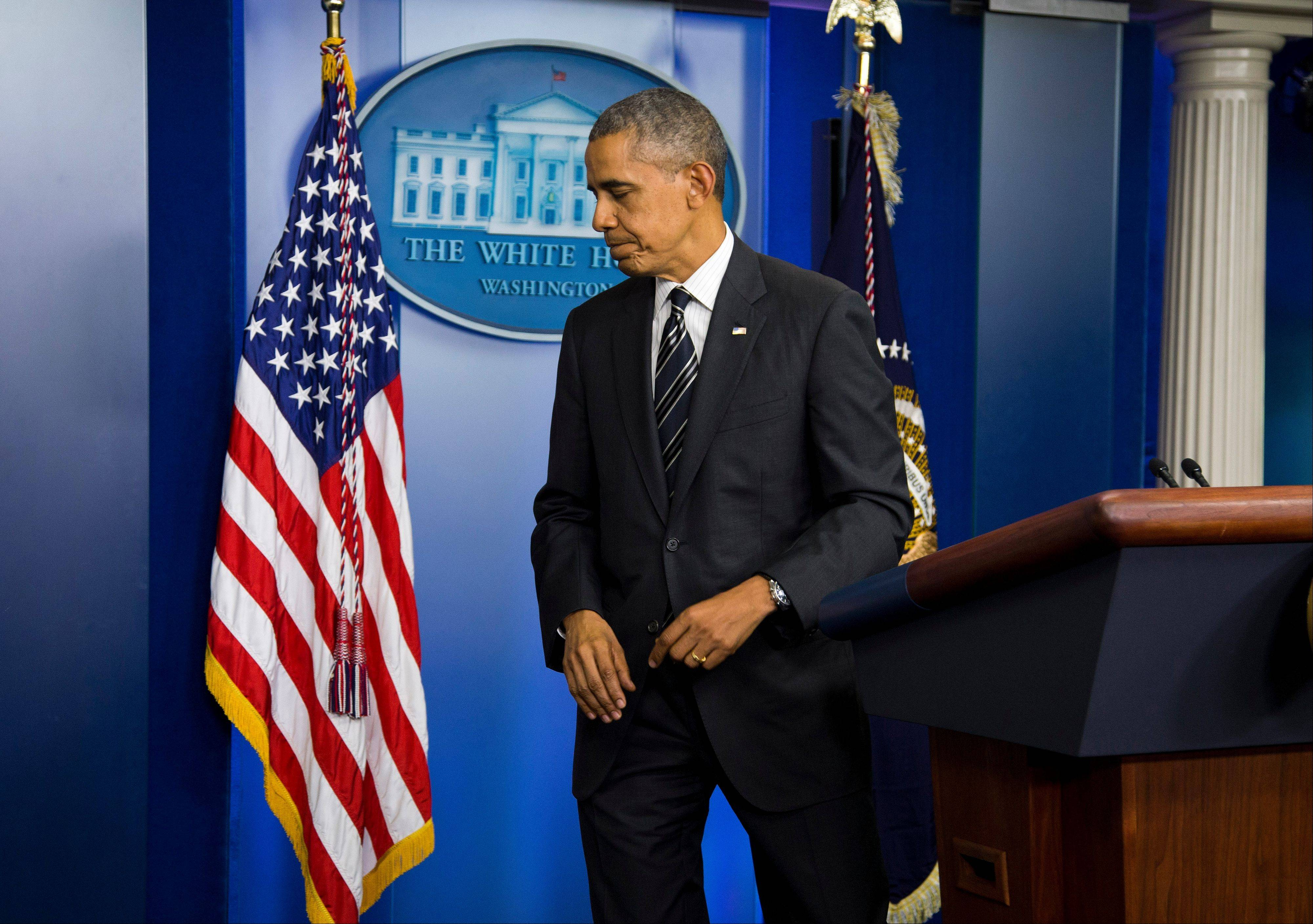 President Barack Obama leaves Friday after making a statement regarding the budget fight in Congress and foreign policy challenges, in the James Brady Press Briefing Room of the White House in Washington.