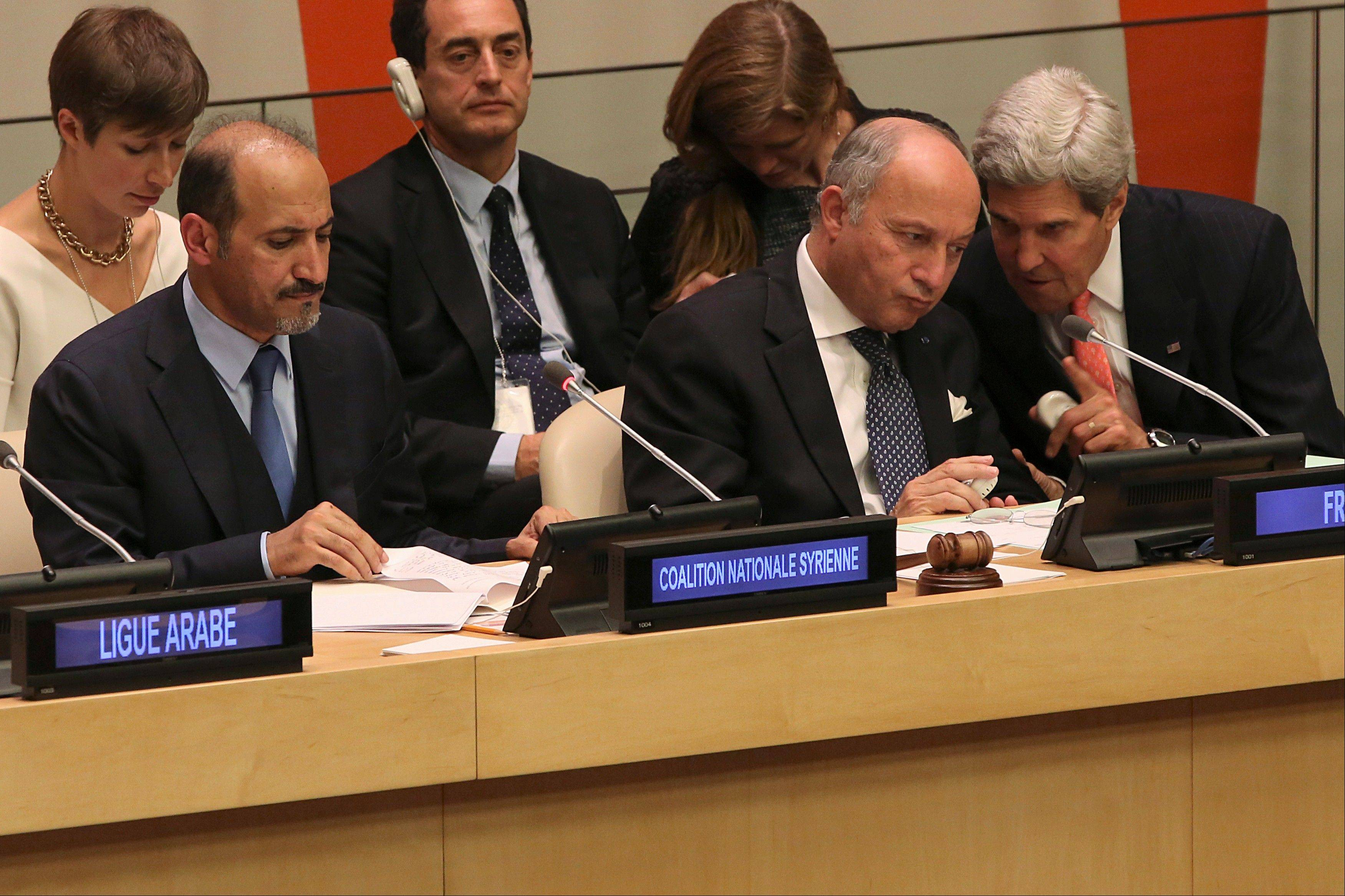 President of the Opposition Syrian Coalition, Ahmad Jarba, left, French Foreign Minister Laurent Fabius, center, and American Secretary of State John Kerry attend a Ministerial Meeting of the Group of Friends of the Syrian people, Thursday, Sept. 26, 2013 at United Nations headquarters.
