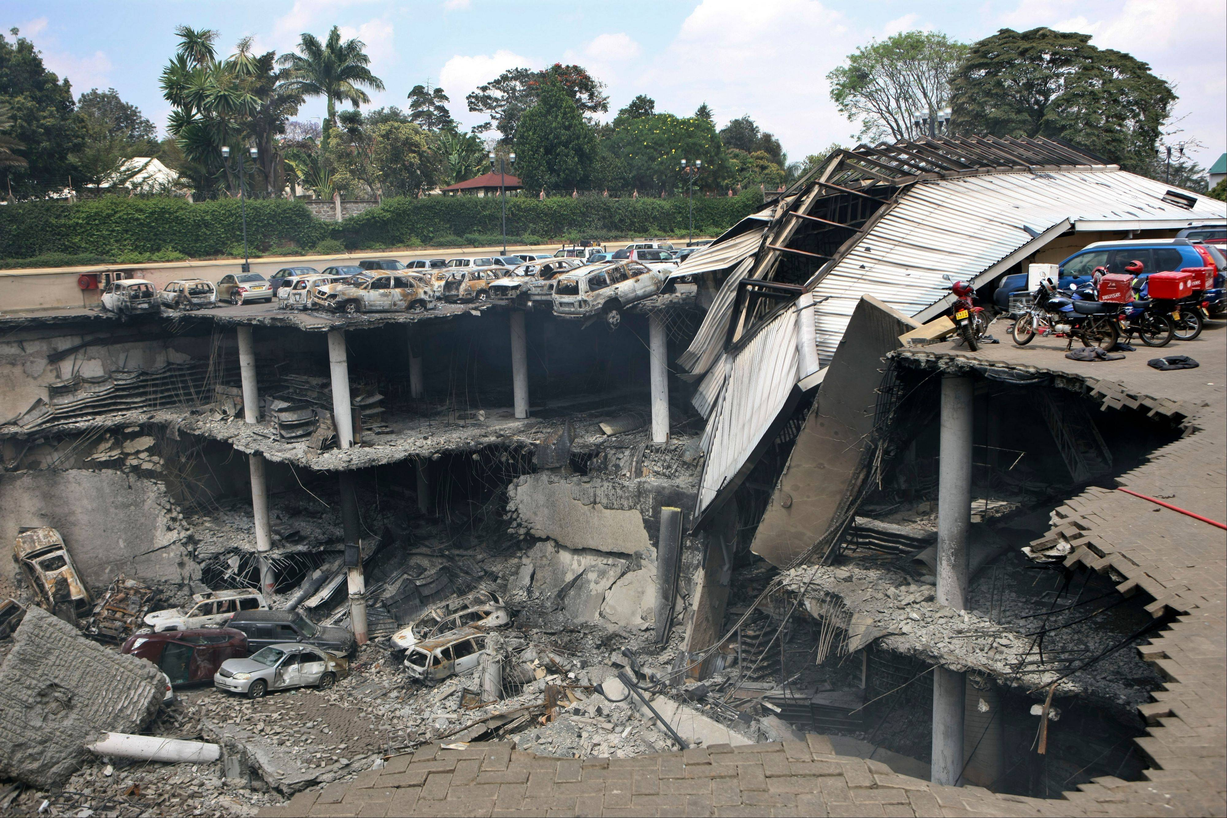 The collapsed upper parking deck atop the Westgate Mall in Nairobi, Kenya, Thursday, Sept. 26, 2013. Kenya�s military caused the massive collapse of three floors of Nairobi�s Westgate Mall during the terrorist siege in which at least 67 people died, a top-ranking government official told The Associated Press.