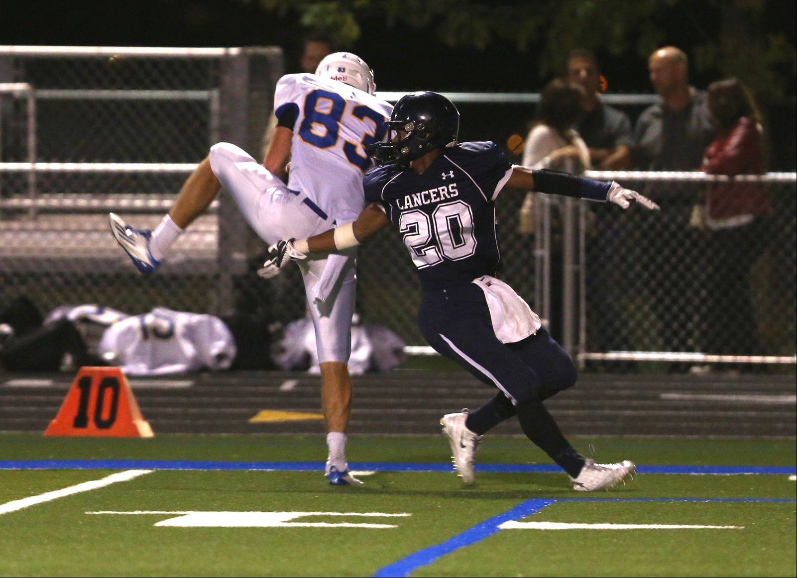 Wheaton North�s Matt Biegalski, left, spins for a touchdown catch over Lake Park�s Antonio Shenault, right.