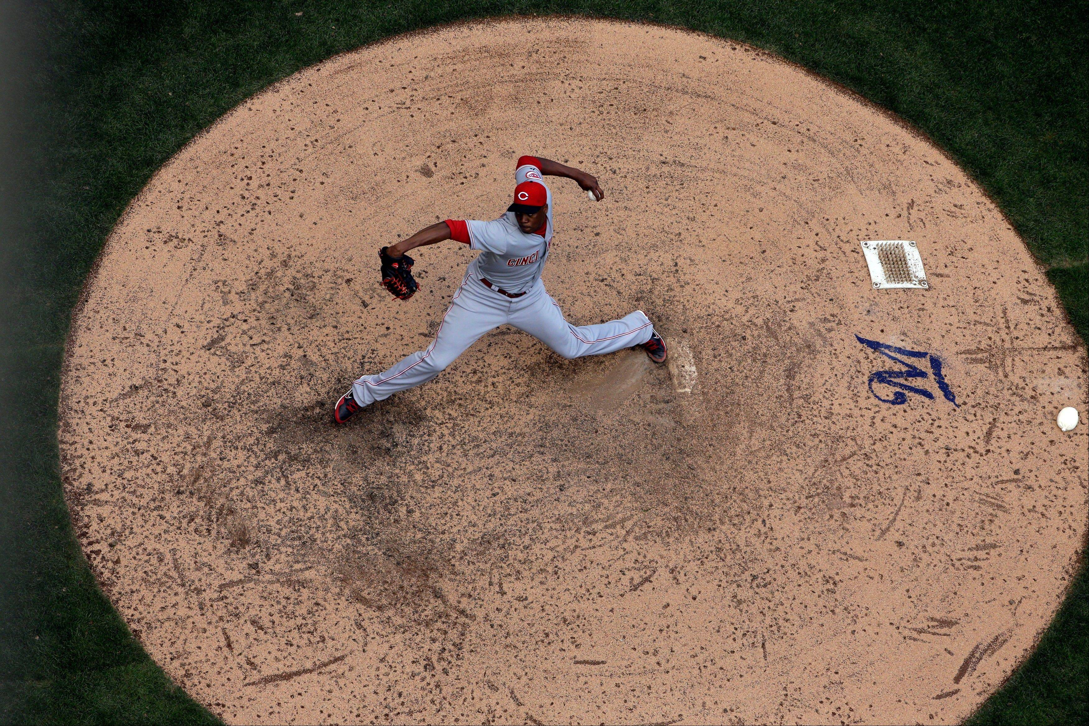 Associated Press/Sept. 14 Cincinnati Reds relief pitcher Aroldis Chapman throws during the eighth inning of a baseball game against the Milwaukee Brewers, in Milwaukee. The fireballer from Holguin, Cuba, who defected in 2009, threw the fastest pitch on record at 105 mph and saved 38 games for Cincinnati this season.