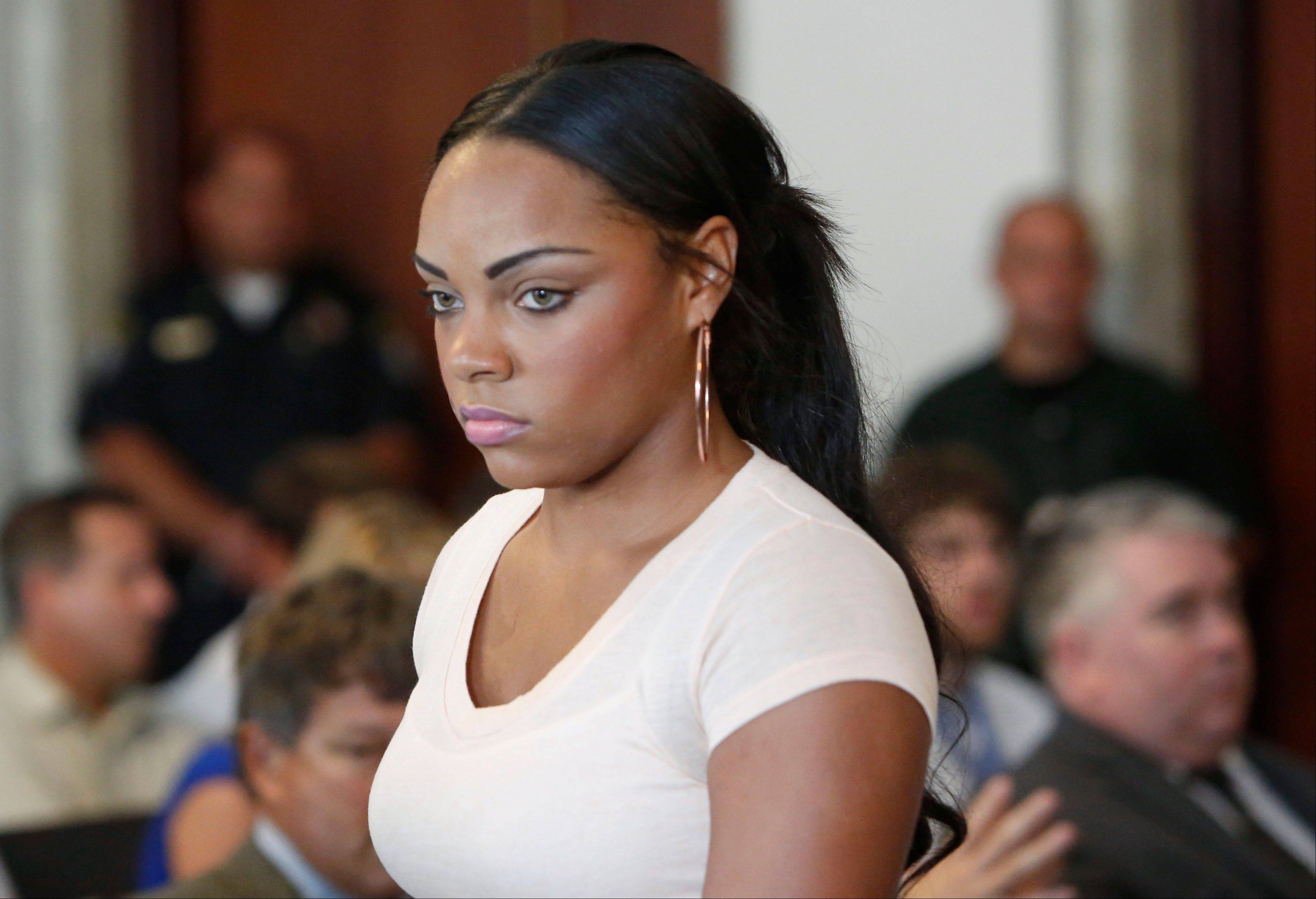 FILE - In this July 24, 2013, file photo, Shayanna Jenkins, fiancee of former New England Patriots NFL football player Aaron Hernandez, arrives at hearing for Hernandez at Attleboro District Courtroom in Attleboro, Mass. A Massachusetts prosecutor said Friday, Sept. 27, 2013, that a grand jury indicted Jenkins on a single count of perjury in relation to the investigation into the June 17 killing of Odin Lloyd. Lloyd had been dating Jenkins' sister. Hernandez has pleaded not guilty to first-degree murder in Lloyd's death and is being held without bail. (AP Photo/Bizuayehu Tesfaye, File)