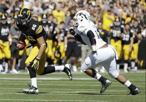 Iowa tight end C.J. Fiedorowicz, left, runs from Western Michigan linebacker Keion Adams after making a reception during last Saturday�s game in Iowa City.