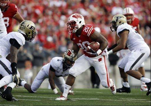 Wisconsin�s James White runs during the second half of last Saturday�s win against Purdue in Madison. Wisconsin is third in the nation in rushing at 350 yards a game.