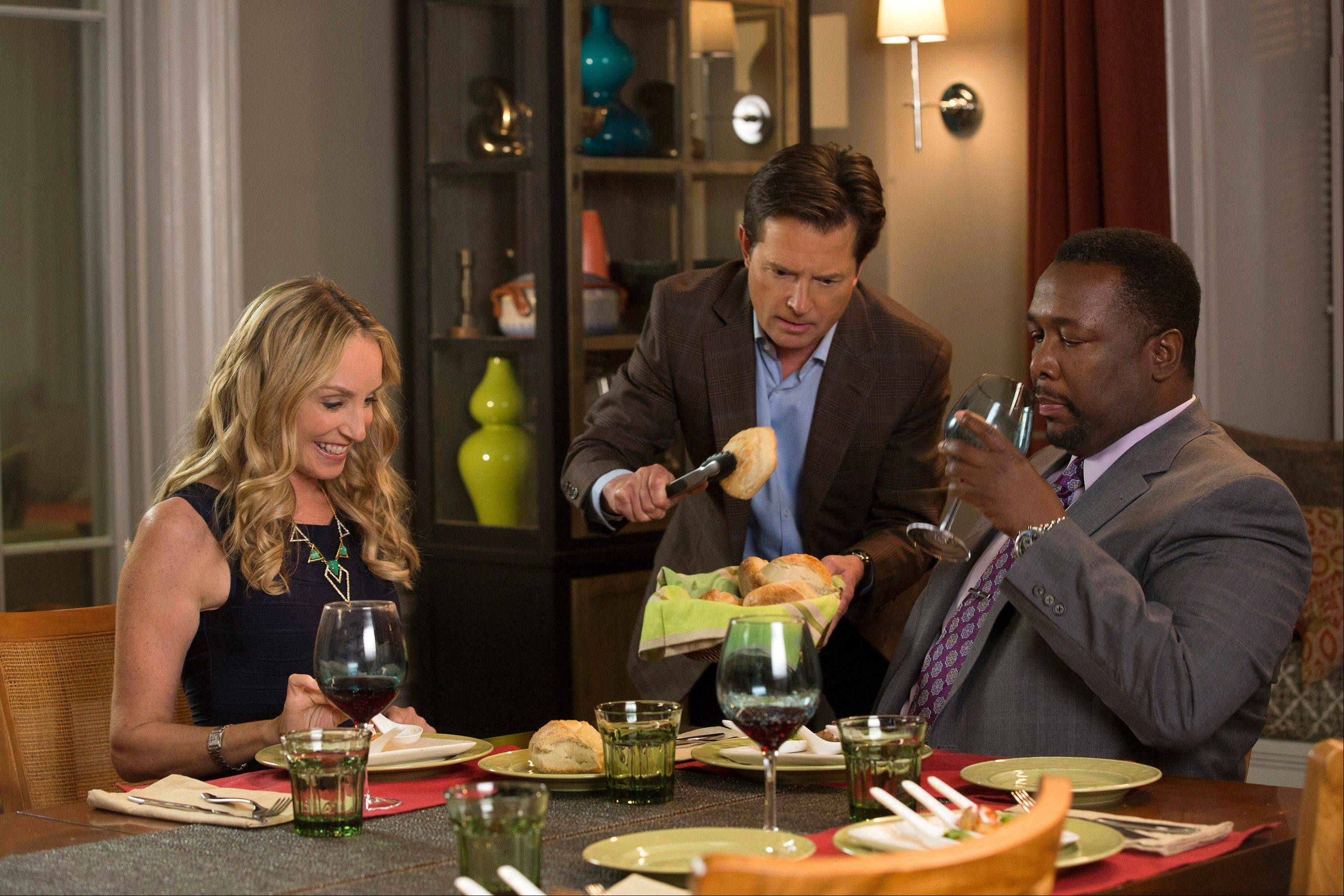 "Tracy Pollan, left, Michael J. Fox, and Wendell Pierce star in NBC's ""The Michael J. Fox Show."""