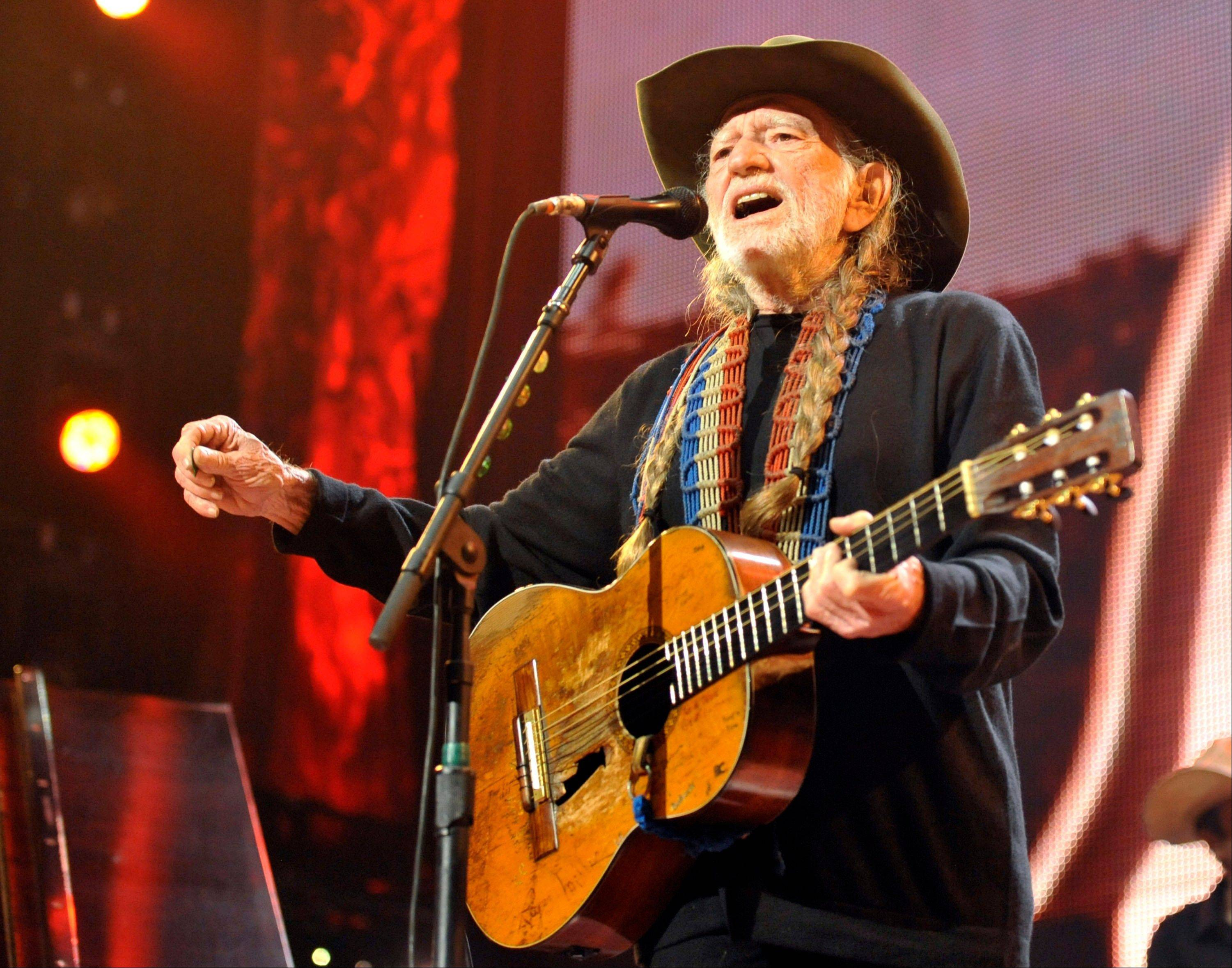 Willie Nelson has recuperated enough from a shoulder injury that he's able to keep his evening slot at the Zac Brown Band's Southern Ground Music & Food Festival on Saturday, Sept. 28, 2013, in Nashville, Tenn. Concerts in Michigan, Indiana and Illinois are being rescheduled.