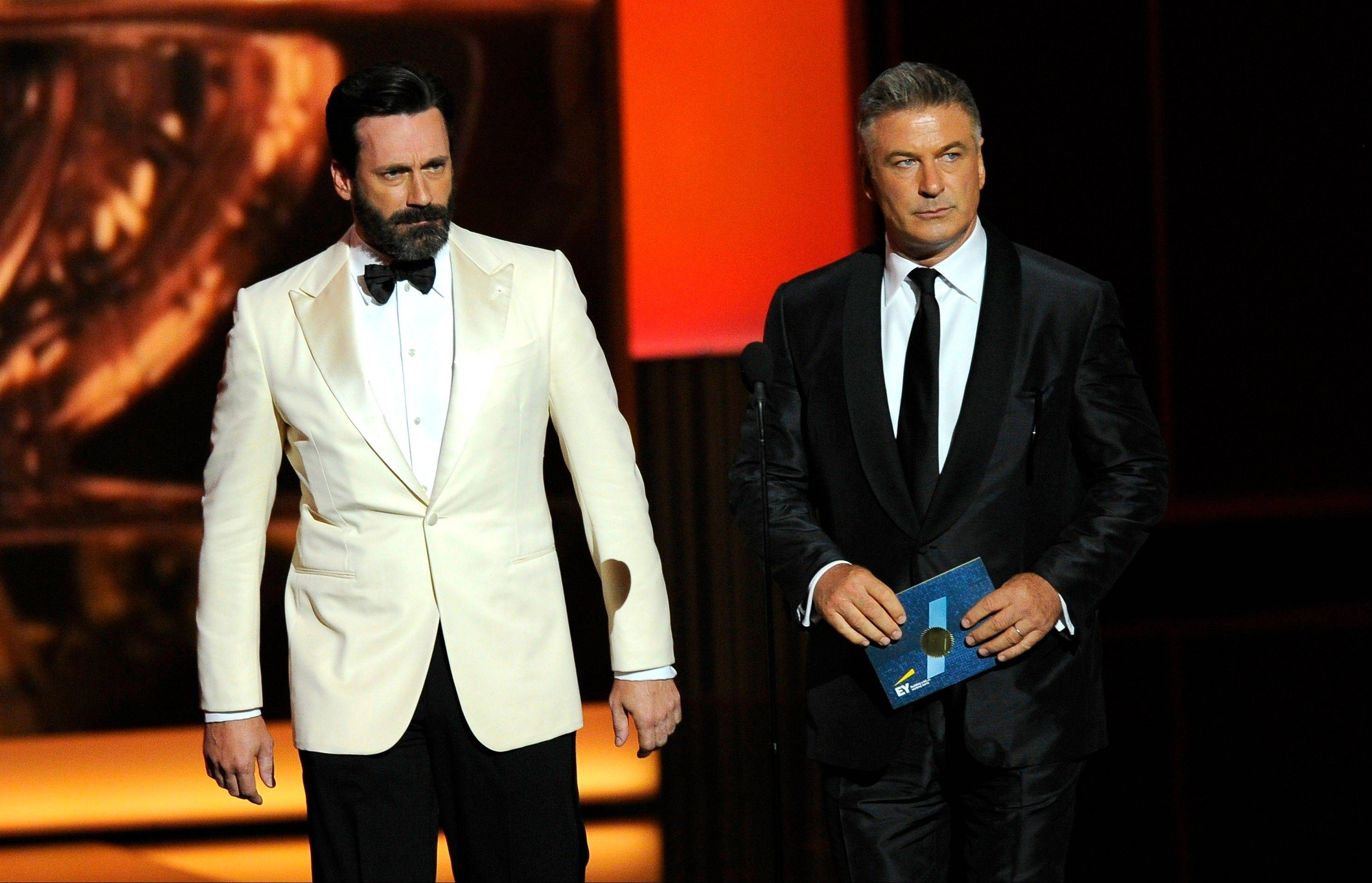 Jon Hamm, left, and Alec Baldwin present the award for outstanding lead actress in a comedy series onstage at the 65th Primetime Emmy Awards at Nokia Theatre, in Los Angeles. Much to Hamm's surprise, it was his new facial hair that made headlines the following day.