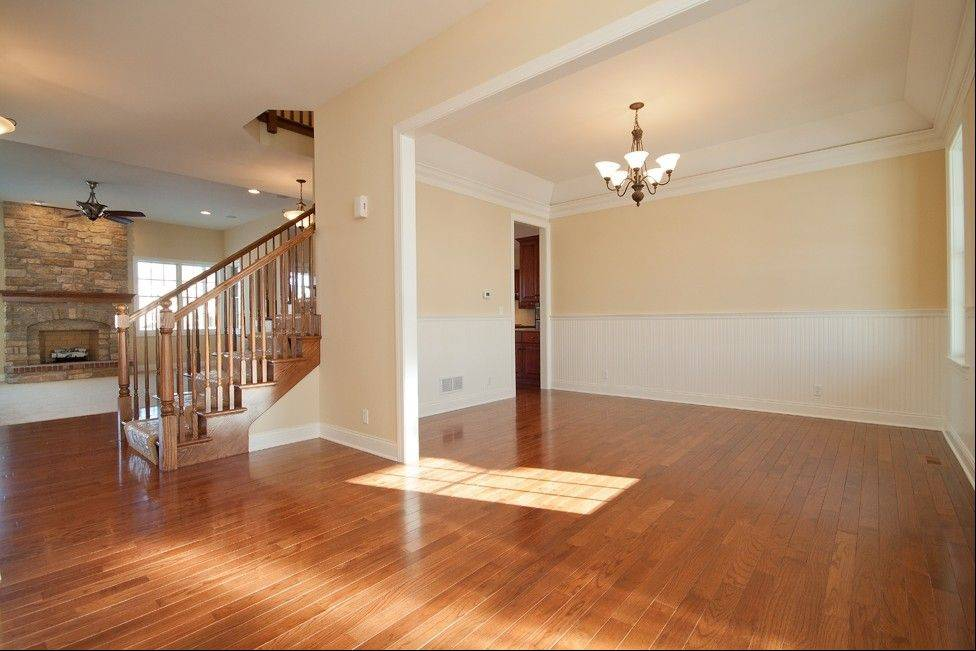 Wood is often the flooring of choice for first-floor living spaces, while carpeting rules in the bedrooms upstairs.