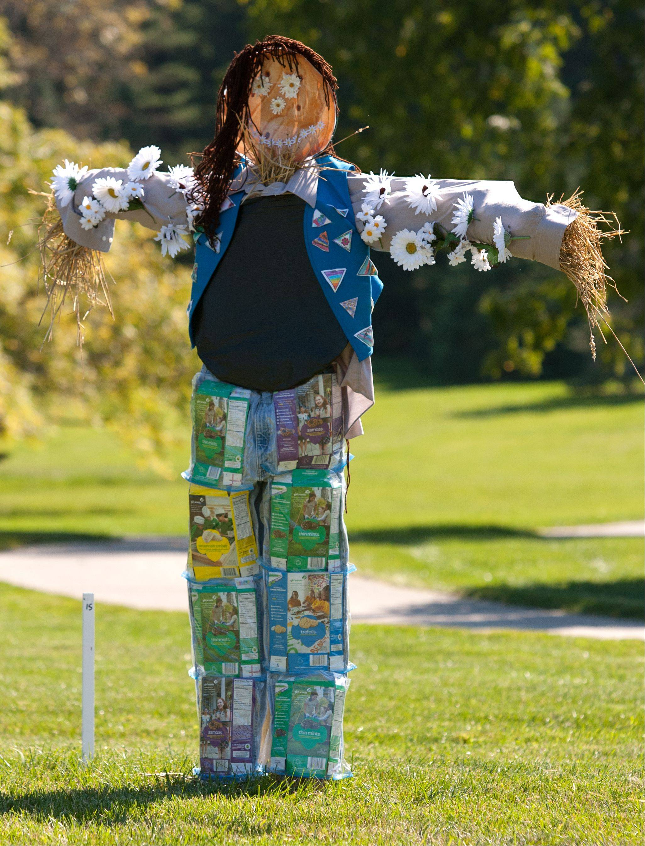 """Cookie Loving Scarecrow,"" designed by Scouts from Briar Glen Elementary School in Wheaton, is one of 45 scarecrows on display this month at the Morton Arboretum in Lisle."