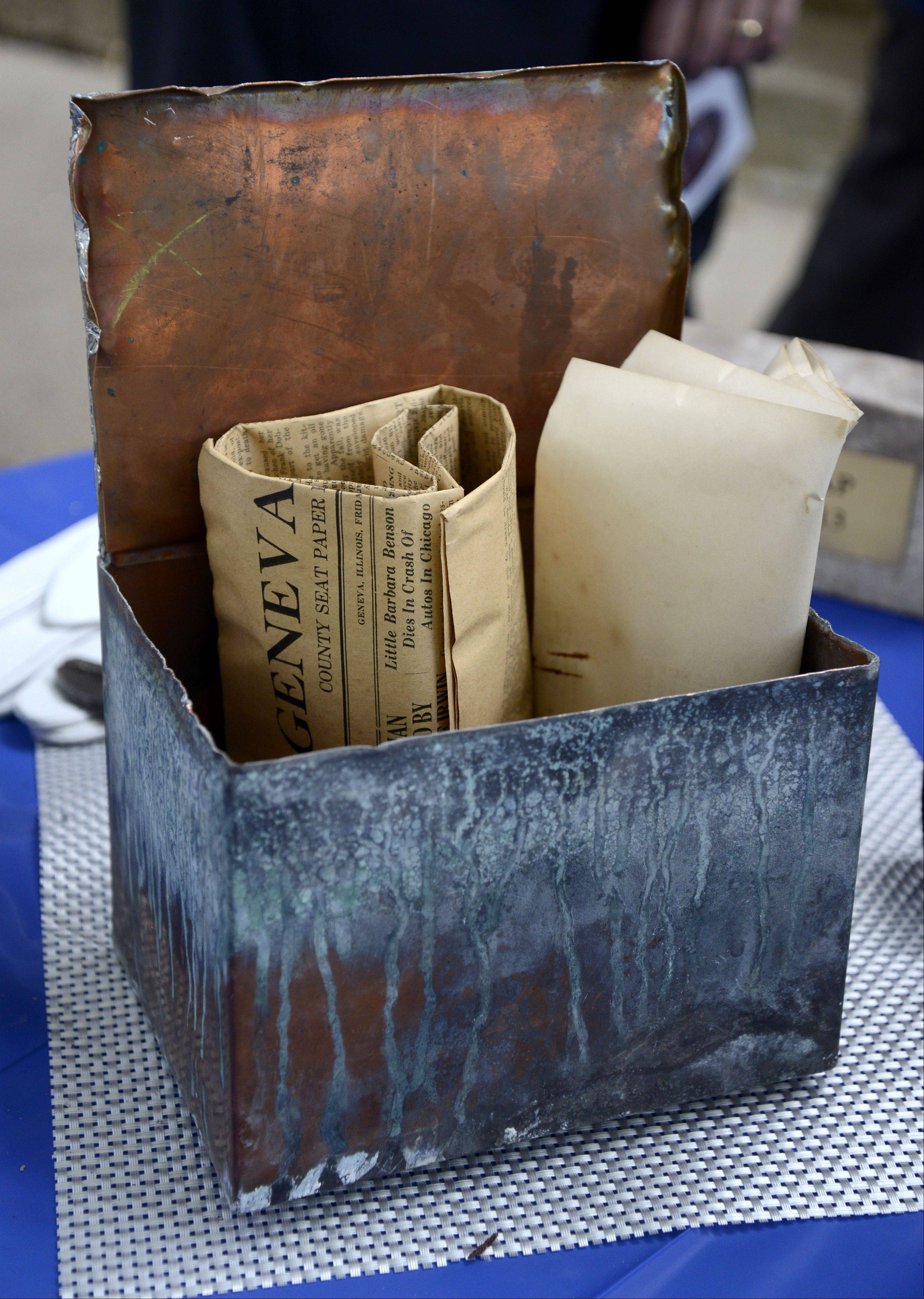 A newspaper dating from Aug. 11, 1922, and the school district's letter of resolution were a few of the items contained in the time capsule dating from 1922 which was stored in a marker stone from the recently razed Coultrap Elementary School in Geneva.