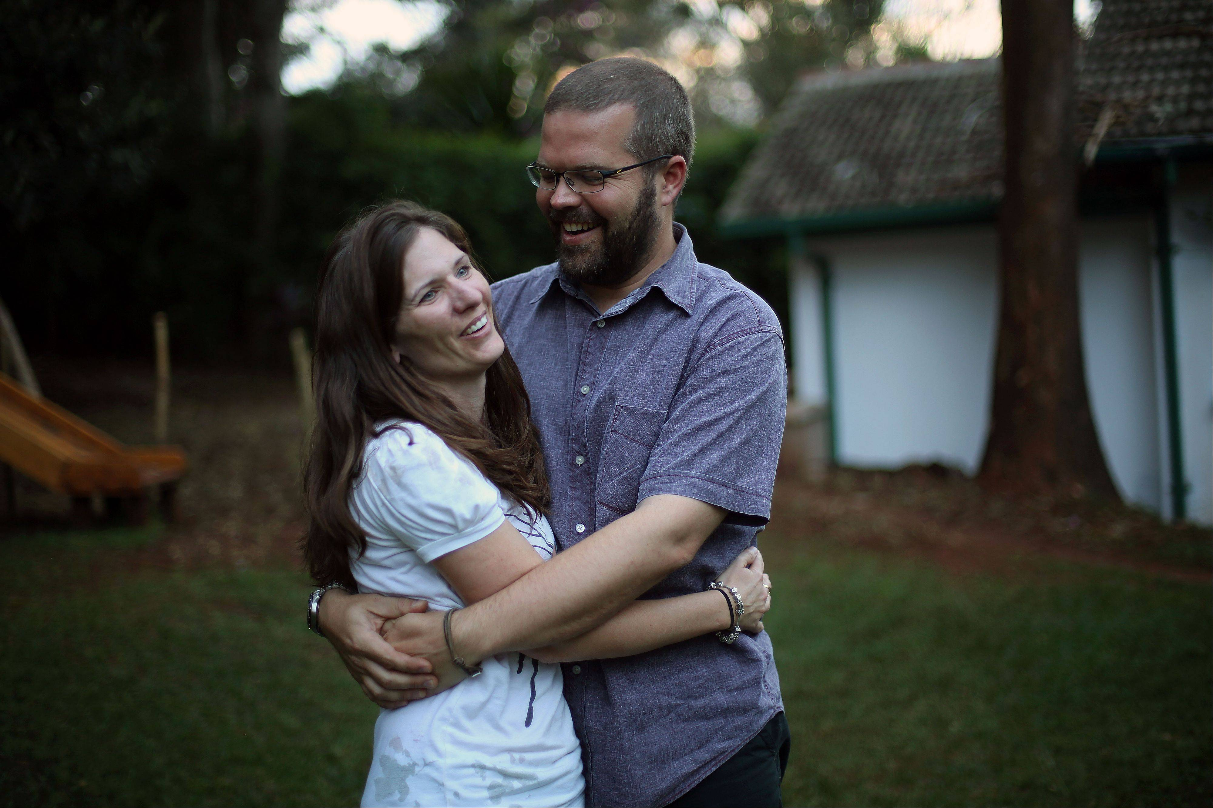 Katherine Walton, 38, from the United States, poses for a photograph Friday with her husband Philip during an interview with the Associated Press in Nairobi, Kenya. Walton survived the Westgate Mall attack with her five children and described the moment she nearly came face to face with the attackers.