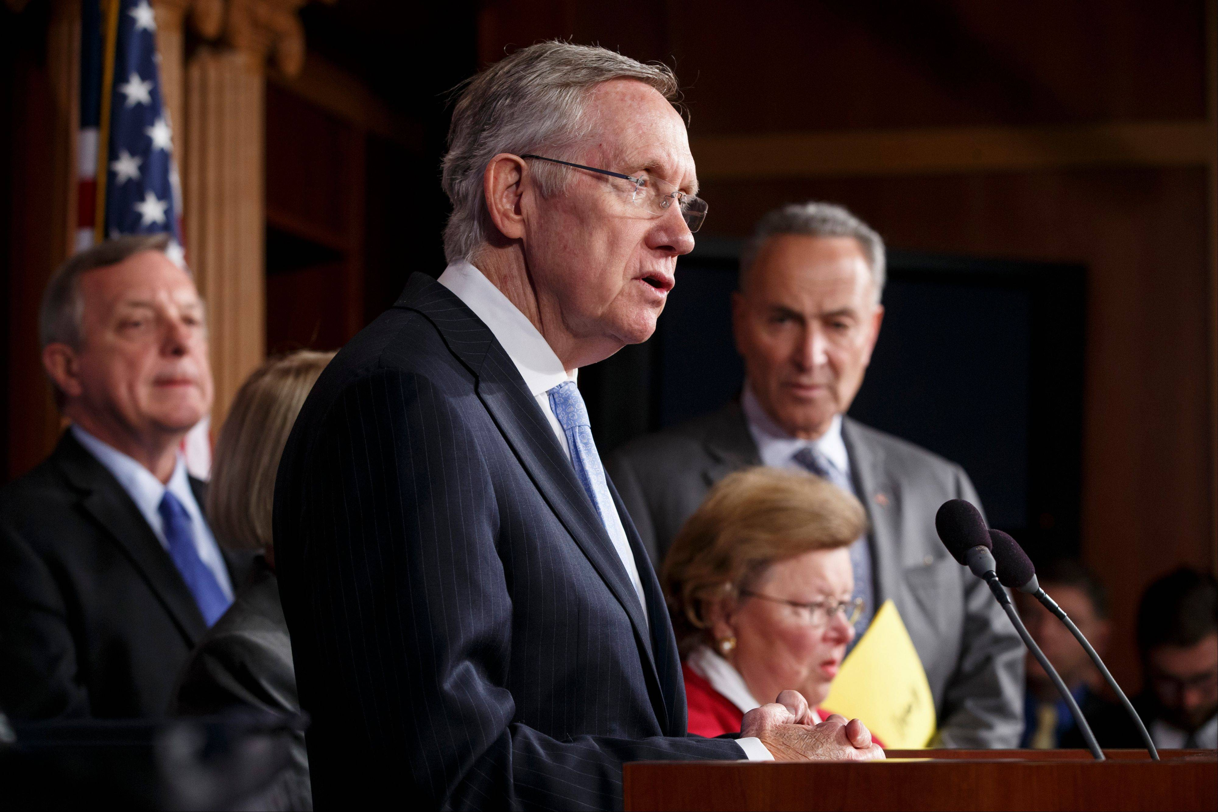 Senate Majority Leader Harry Reid of Nev., center, joined by Senate Democratic leaders, speaks during a news conference Thursday to blame conservative Republicans for holding up a stopgap spending bill to keep the government runni