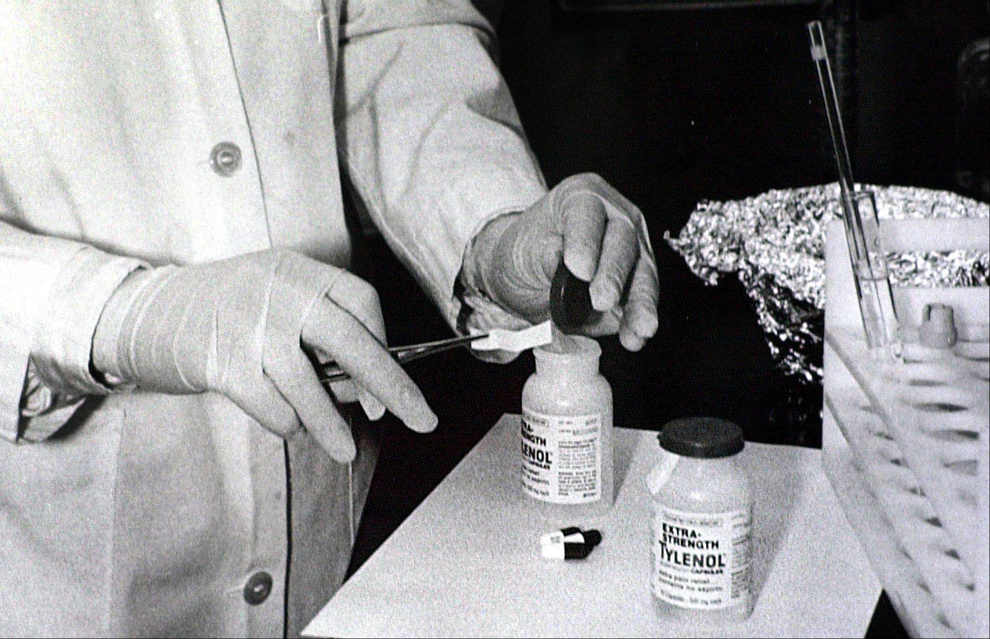 Bottles of Extra-Strength Tylenol were tested with a chemically treated paper that turns blue in the presence of cyanide at the Illinois Department of Health in October 1982 in Chicago.